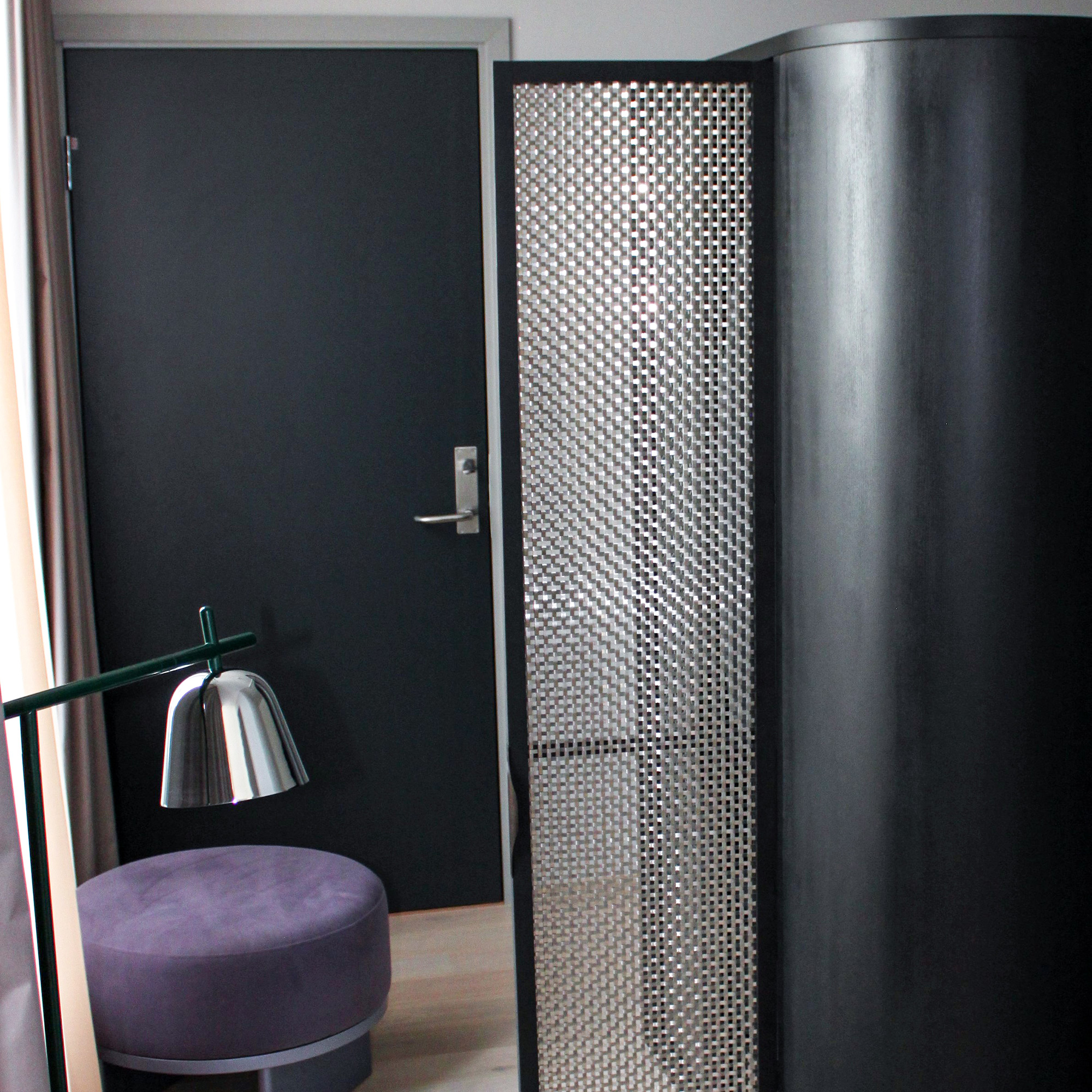 Banker Wire's S-30 woven wire mesh used as part of the cabinetry doors in the Clarion Hotel Oslo rooms.