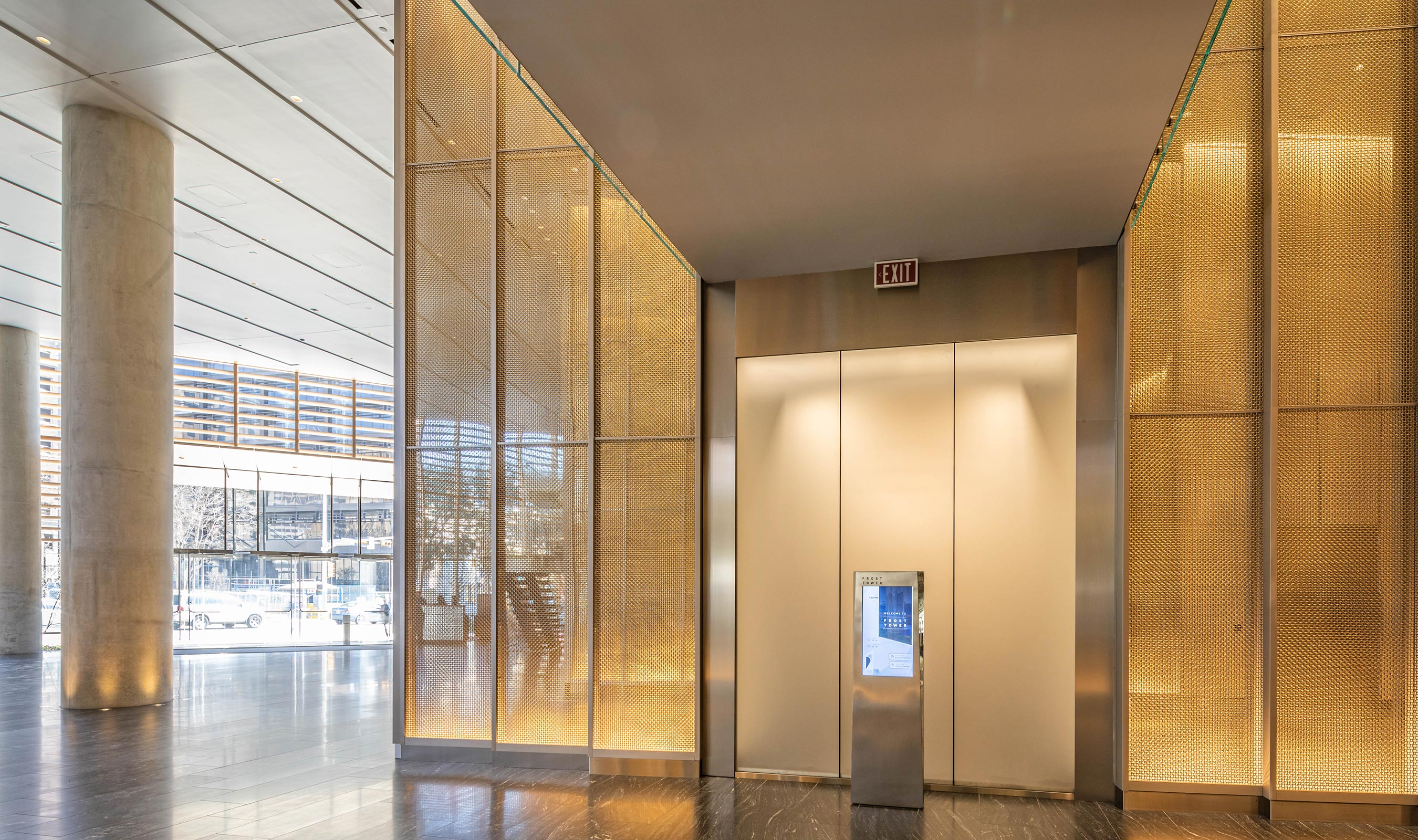 Mirrors behind M22-80 reflect and throw light to enhance the sparkle of the woven wire mesh feature walls.