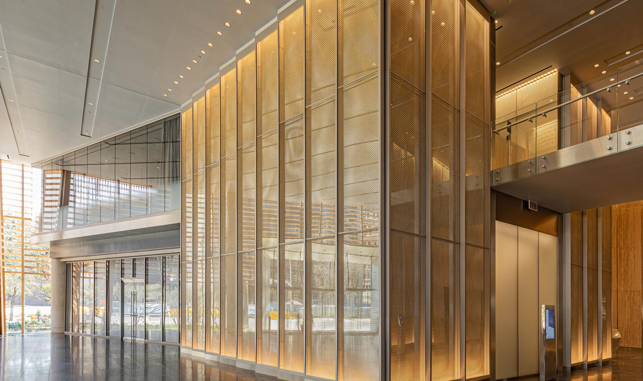 Banker Wire's M22-80 in stainless steel and brass clad against mirrors in the Frost Bank Tower lobby creates a beautiful sparkle and visual interest.