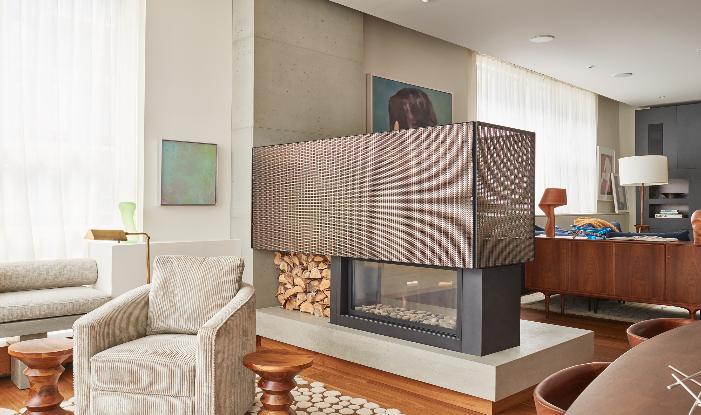 Banker Wire's Antique Brass plated SZ-3 woven wire mesh is used as part of a stunning custom fireplace in the Jane Hope Residence in Toronto.