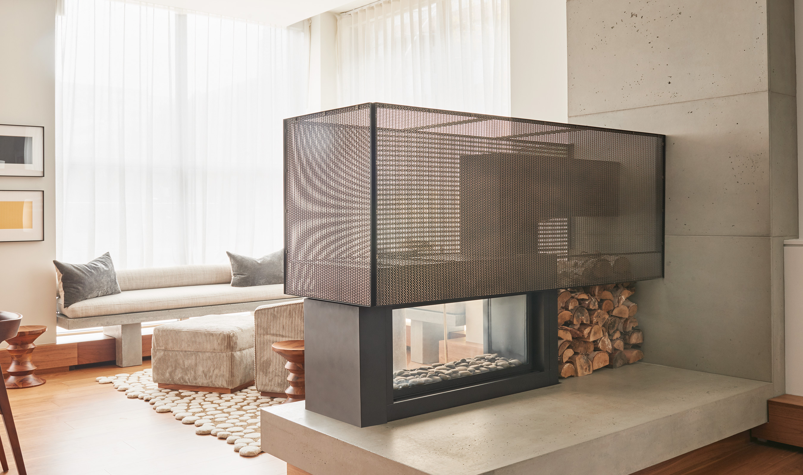 The semi-transparent nature of Banker Wire's SZ-3 woven wire mesh allows natural light to pass through the fireplace and highlights the modern aesthetic of the home.