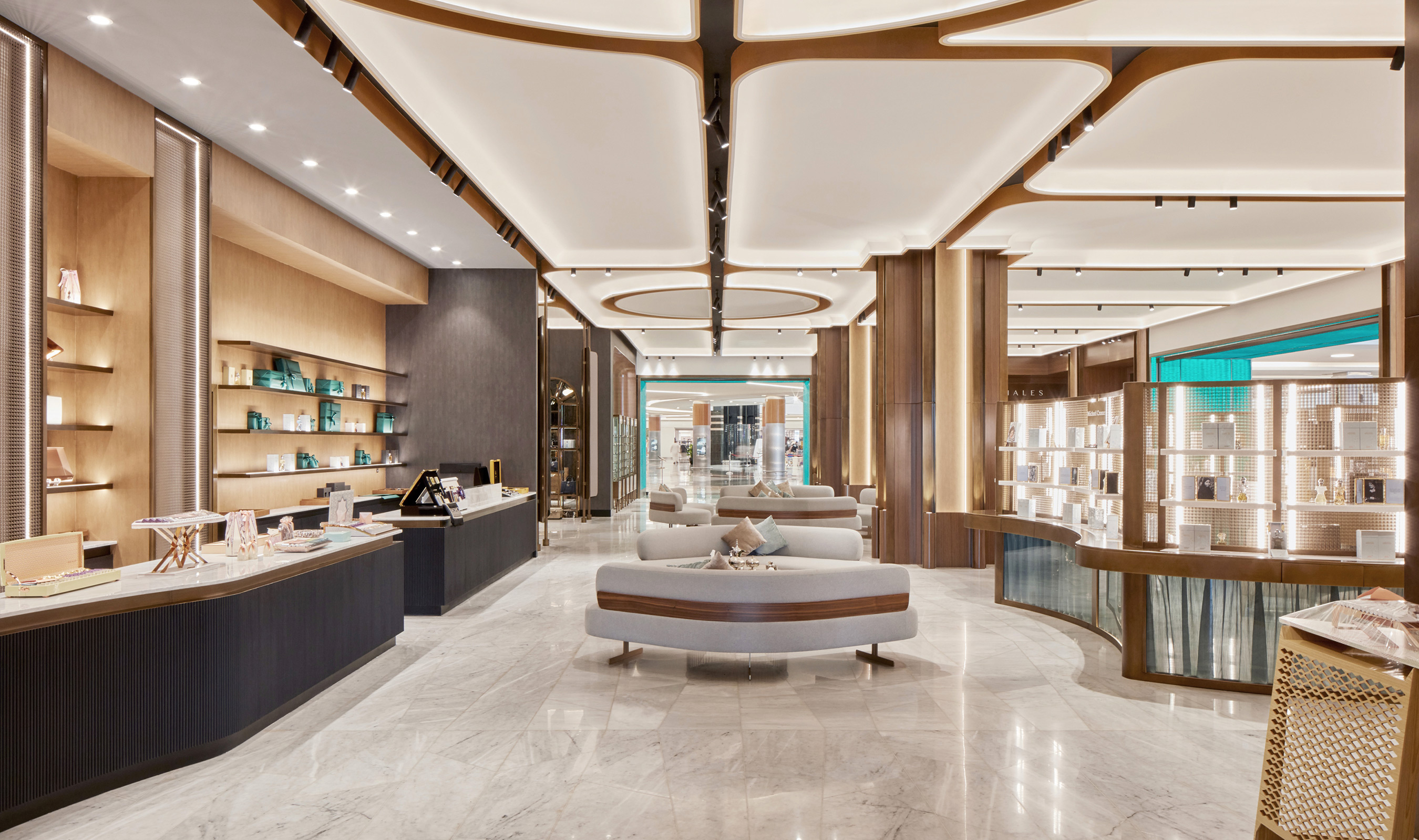 Wall cladding and retail displays at the HOB luxury store in Abu Dhabi use Banker Wire's M22-22 brass woven wire mesh.