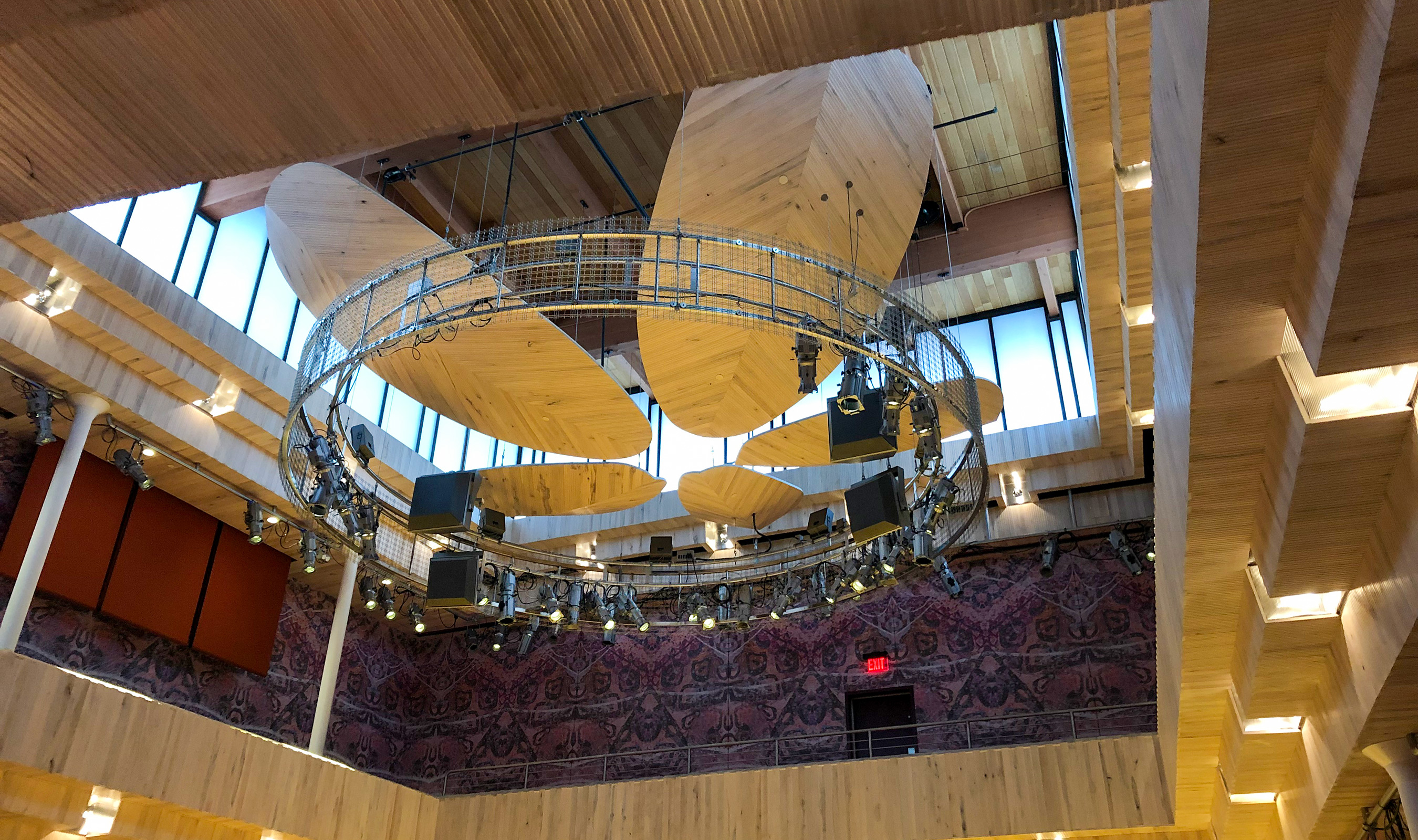 A frameless approach was taken with Banker Wire's M24Z-12 woven wire mesh for the two custom tiaras that house lighting and sound equipment in the Collins Recital Hall.
