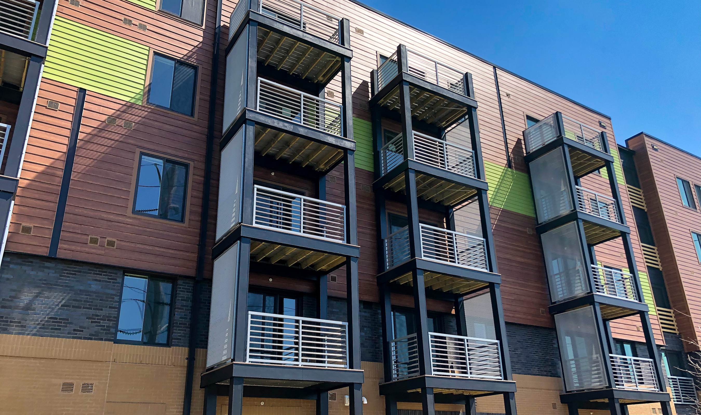 The Apex apartments use Banker Wire's LPZ-54 woven wire mesh as privacy screens on the balconies.