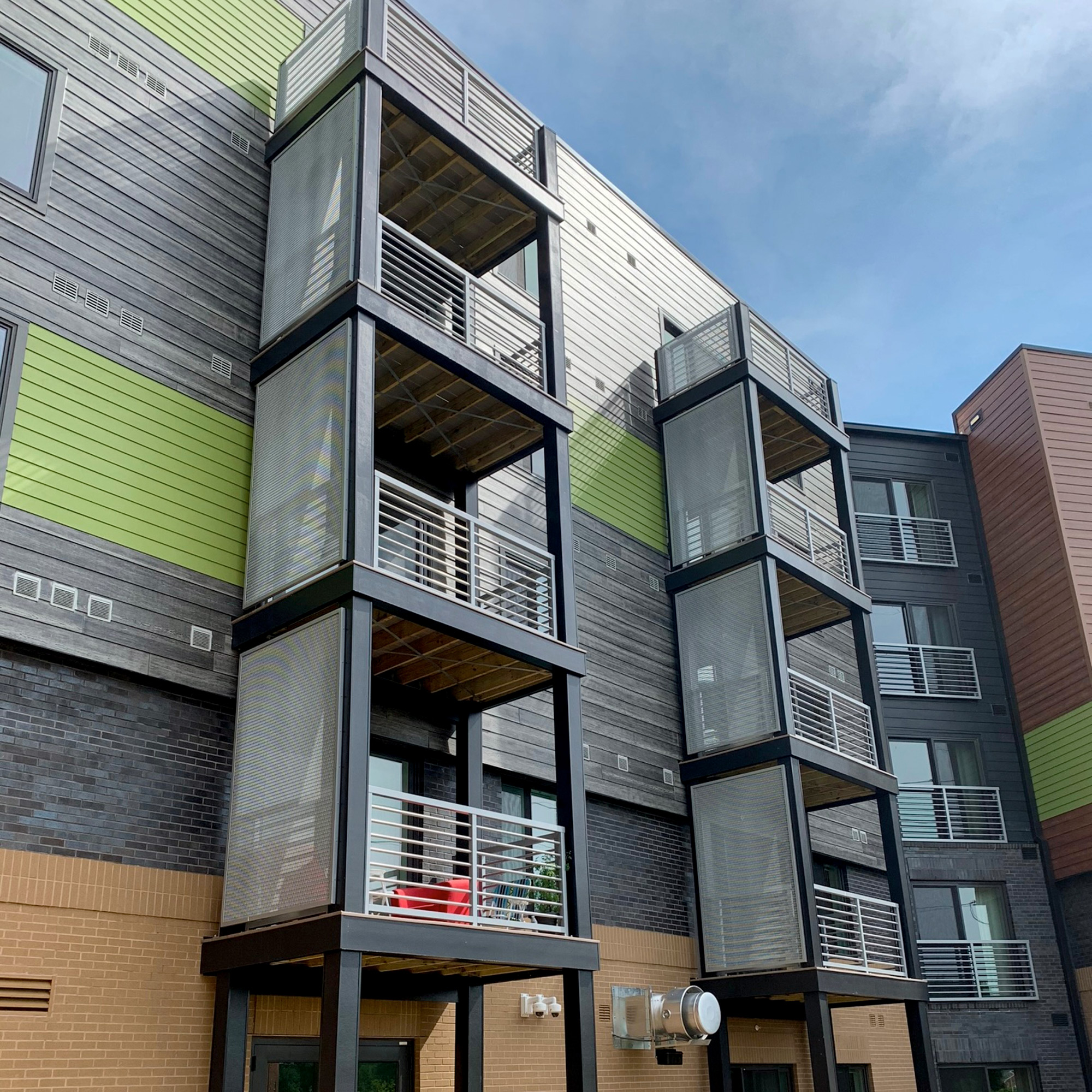 These balcony privacy screens at The Apex in Arlington, Virginia, use Banker Wire's LPZ-54 woven wire mesh.