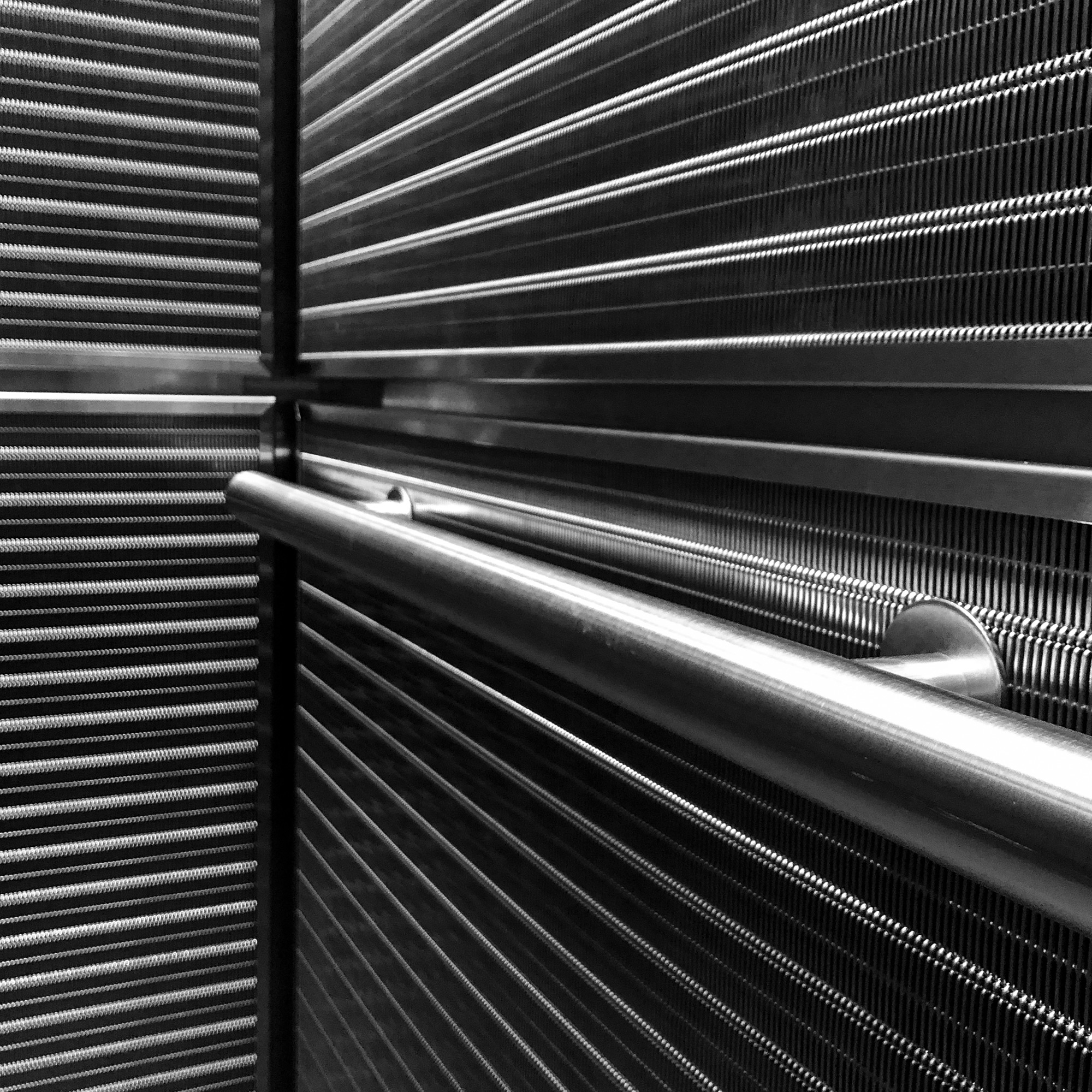 The elevators at the Avalon in Newton Highlands utilizes Banker Wire's DF-6 in Stainless Steel as elevator wall cladding.