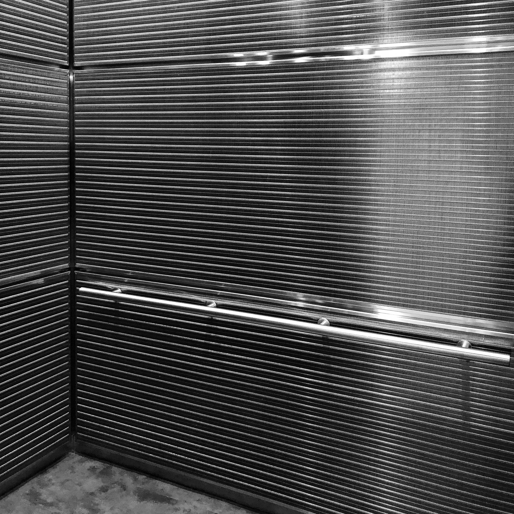 The distinct DF-6 woven wire mesh pattern by Banker Wire is used as elevator cladding in the Avalon at Newton Highlands luxury apartments.