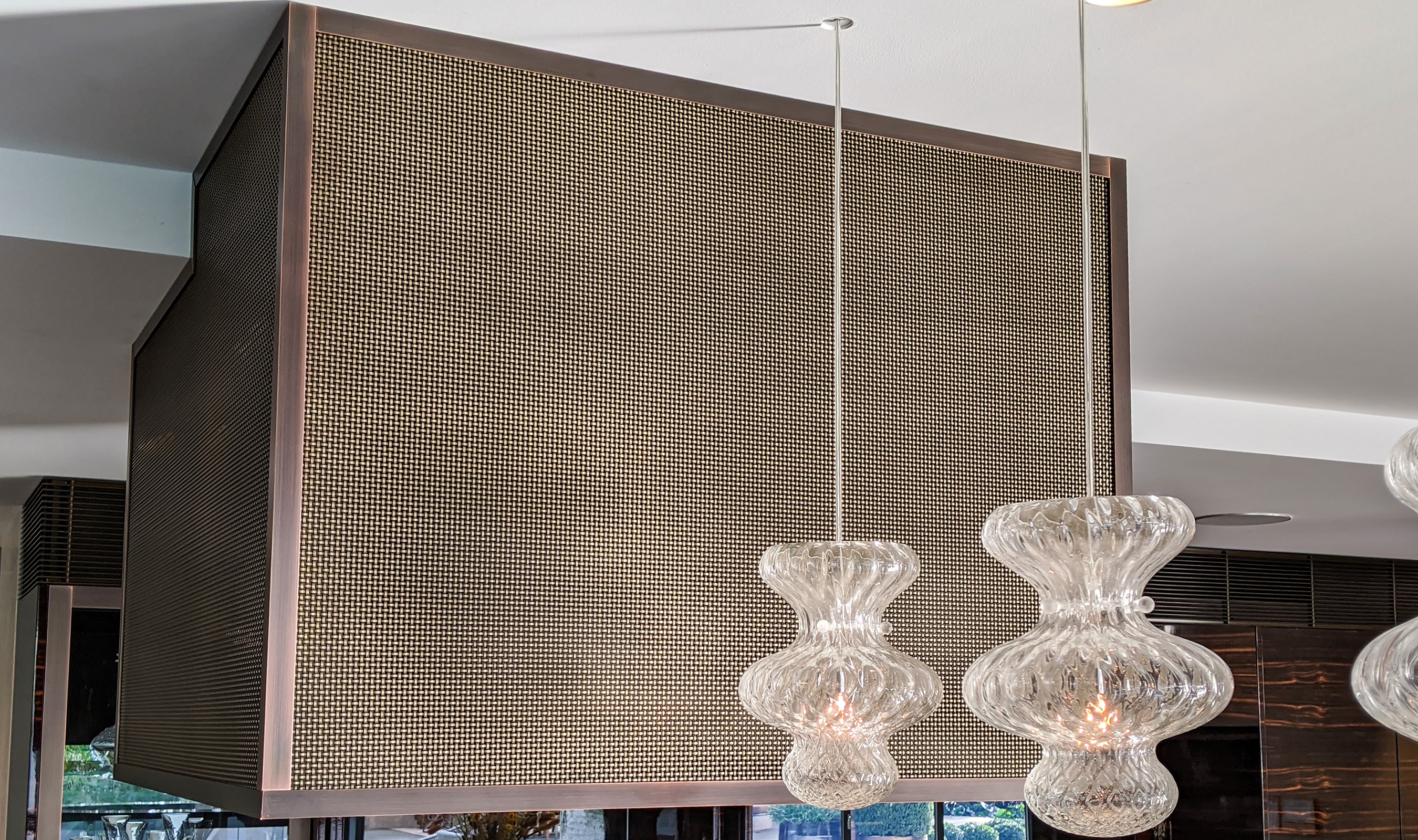 Banker Wire's S-32 is Antique Brass plated and used as range hood cladding in this modern Sydney, Austraila home.