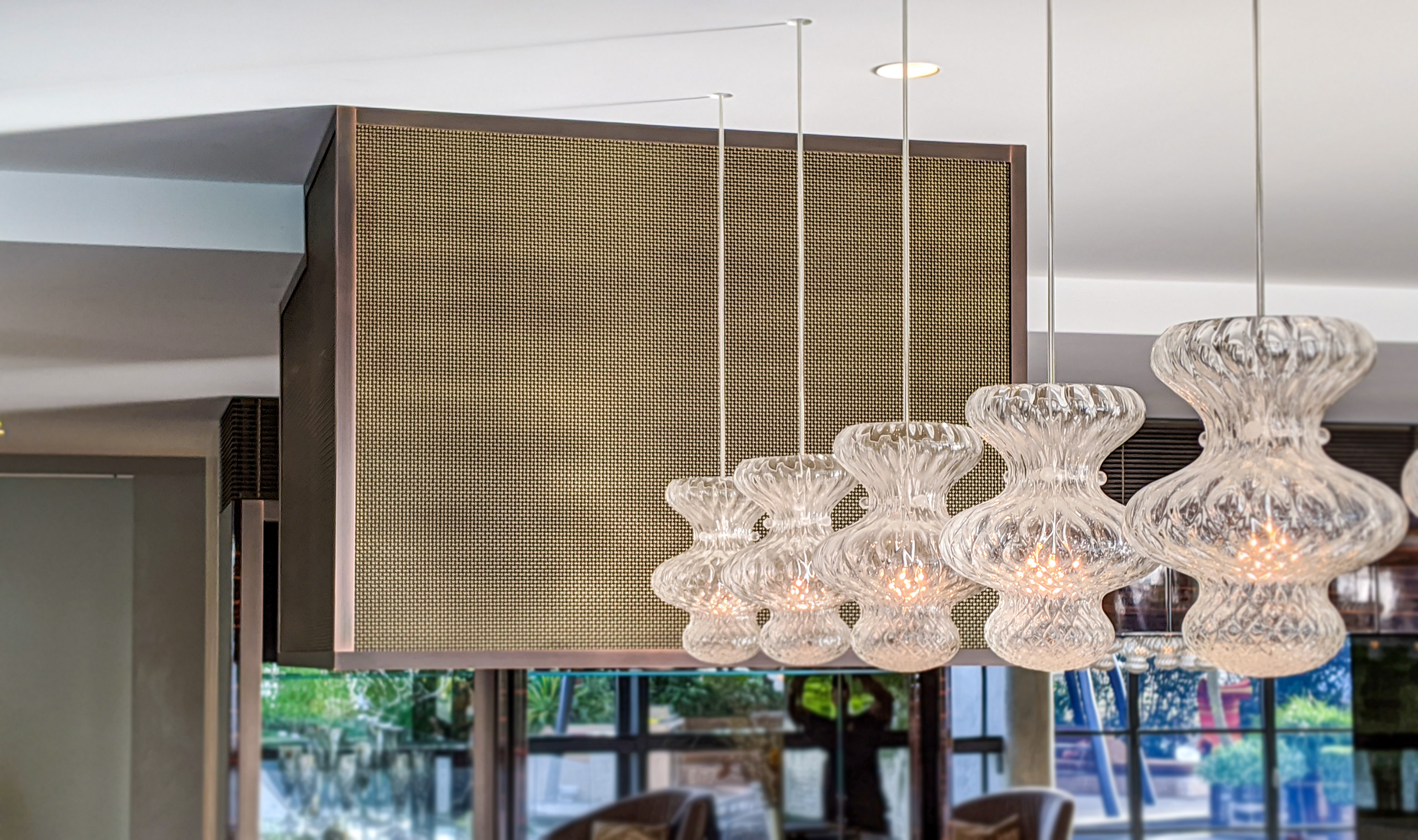 Banker Wire's S-32 woven wire mesh is used in this Sydney, Australia residence as cladding for a modern range hood.