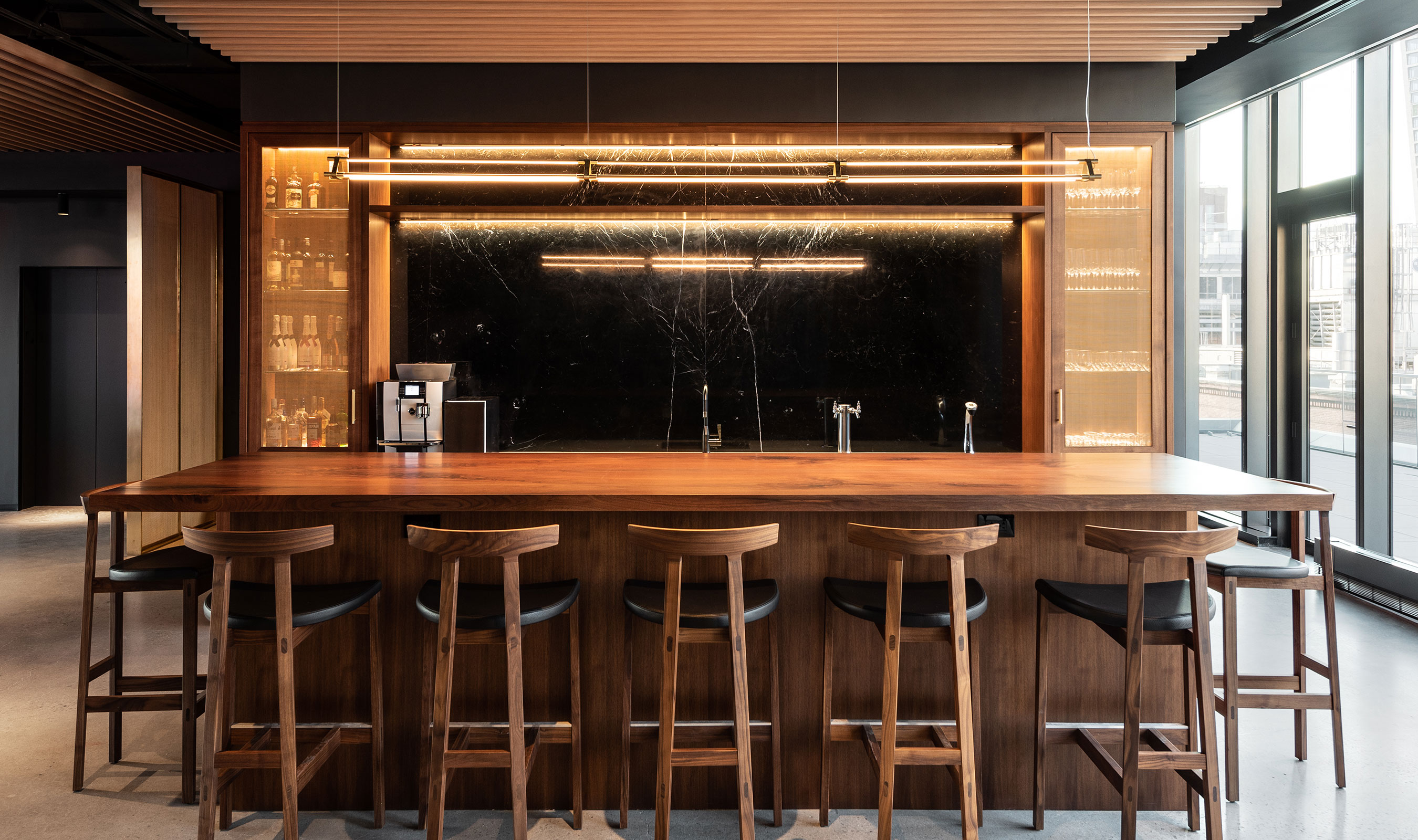 Banker Wire's S-51 in bronze is used in Project Worldwide's headquarters as bar cabinetry.