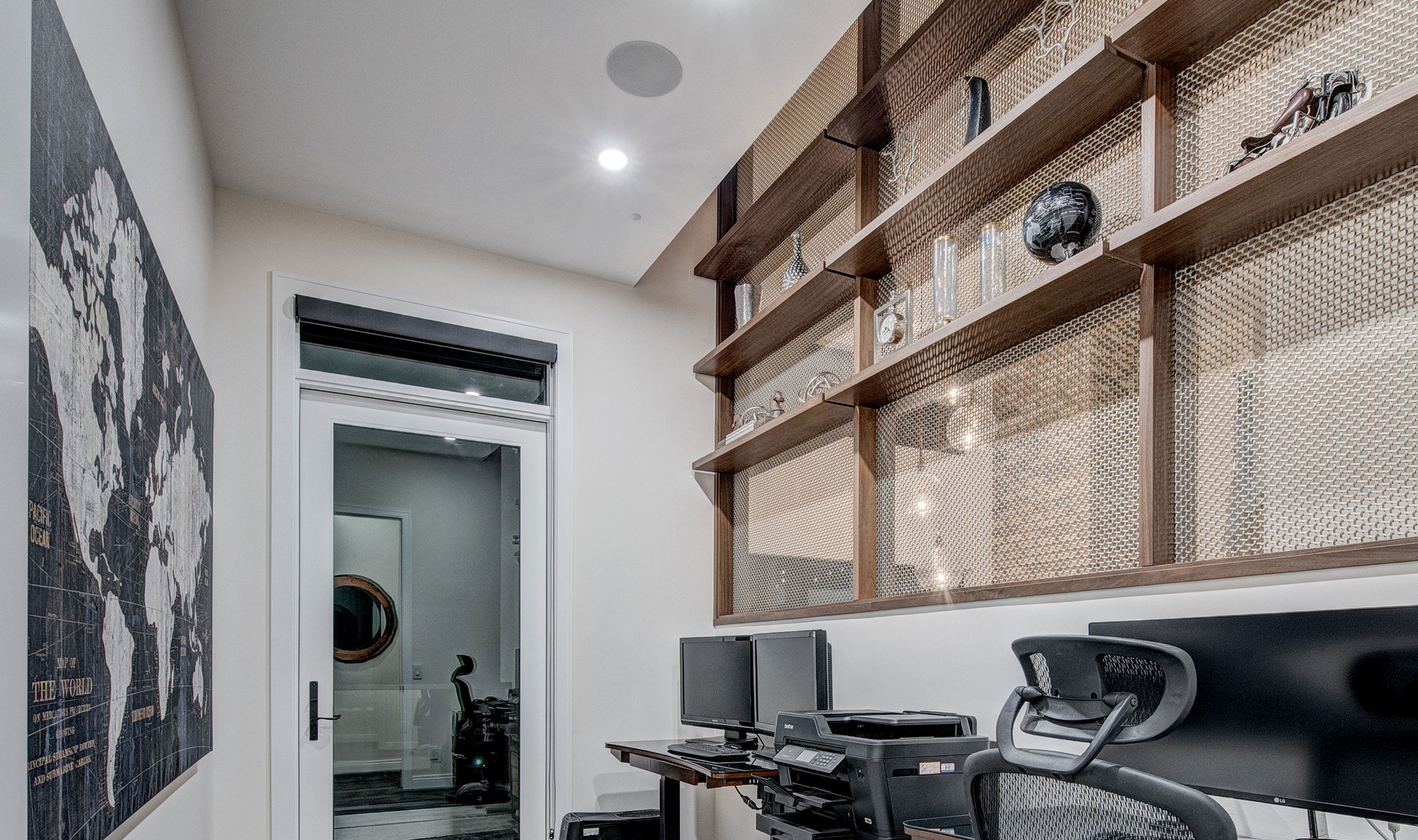 The office in the Willow Park Showhome utilizes Banker Wire's M22-83 woven wire mesh pattern in Stainless Steel and Brass.