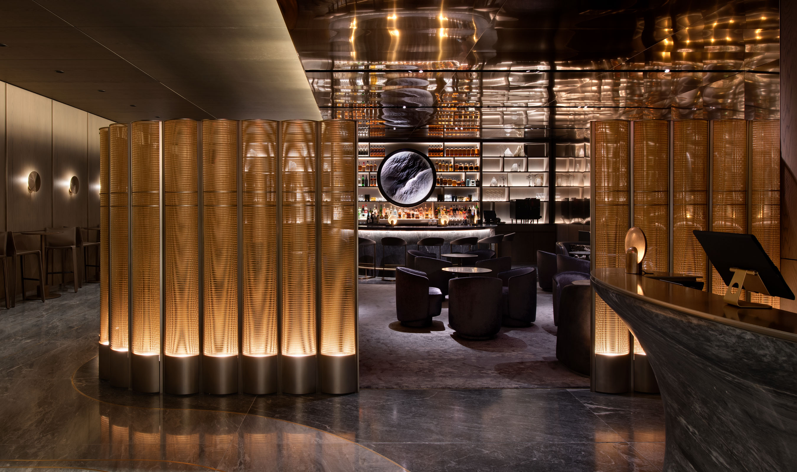 Peak Restaurant inside 30 Hudson Yards, in New York City, uses Banker Wire's PZ-52 woven wire mesh in Bronze and a stunning and unique interior space divider.