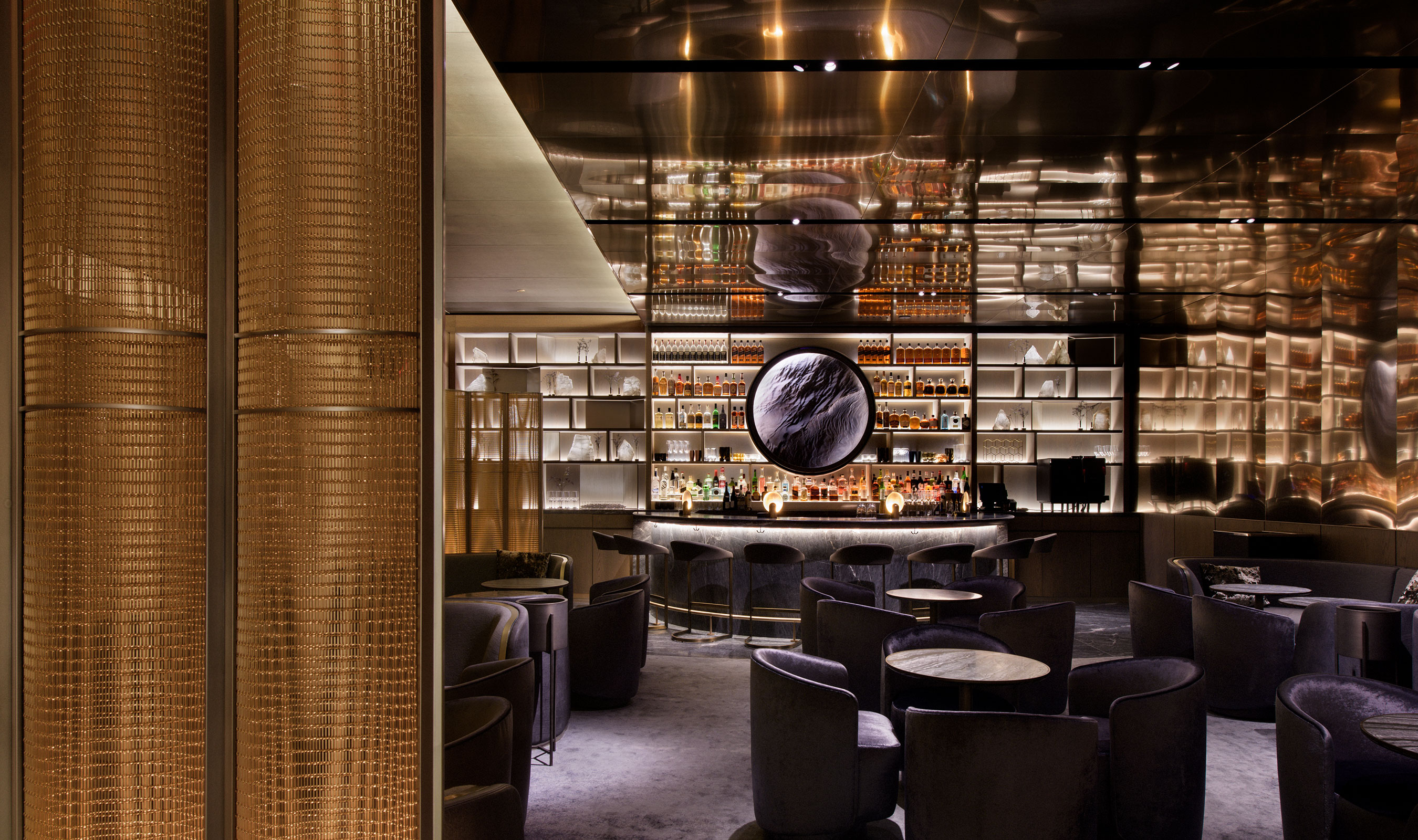 The stunning SPZ-52 in bronze by Banker Wire is features as a unique and beautiful space divider within Peak Restaurant at 30 Hudson Yards.