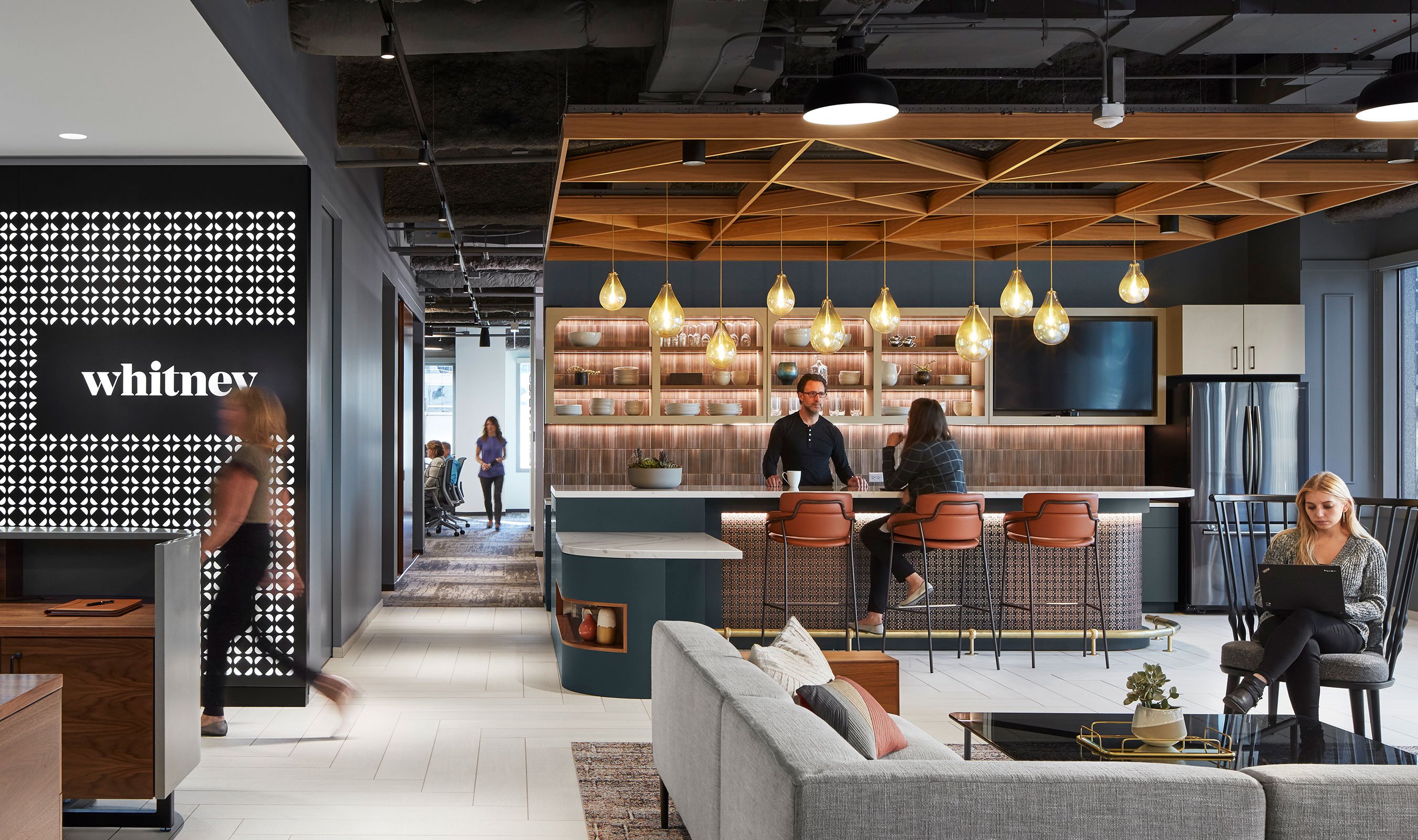 The Whitney Architects Head Quarters in Chicago uses Banker Wire's M33-5 in Antique Brass Decorative Plating as cladding for the work café space.
