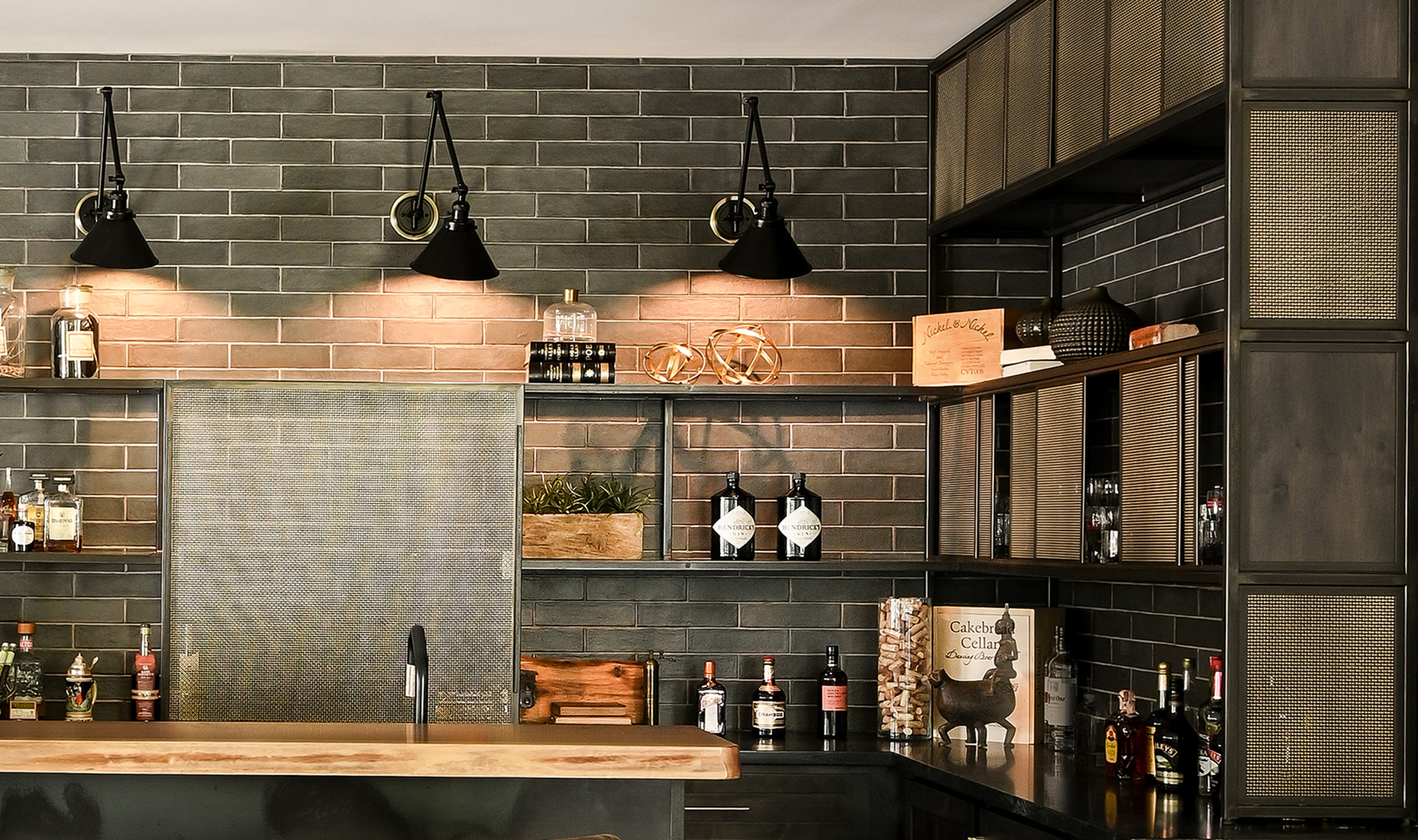 Woven wire mesh pattern S-12 creates a reflective surface to enhance the lighting in the game room bar.