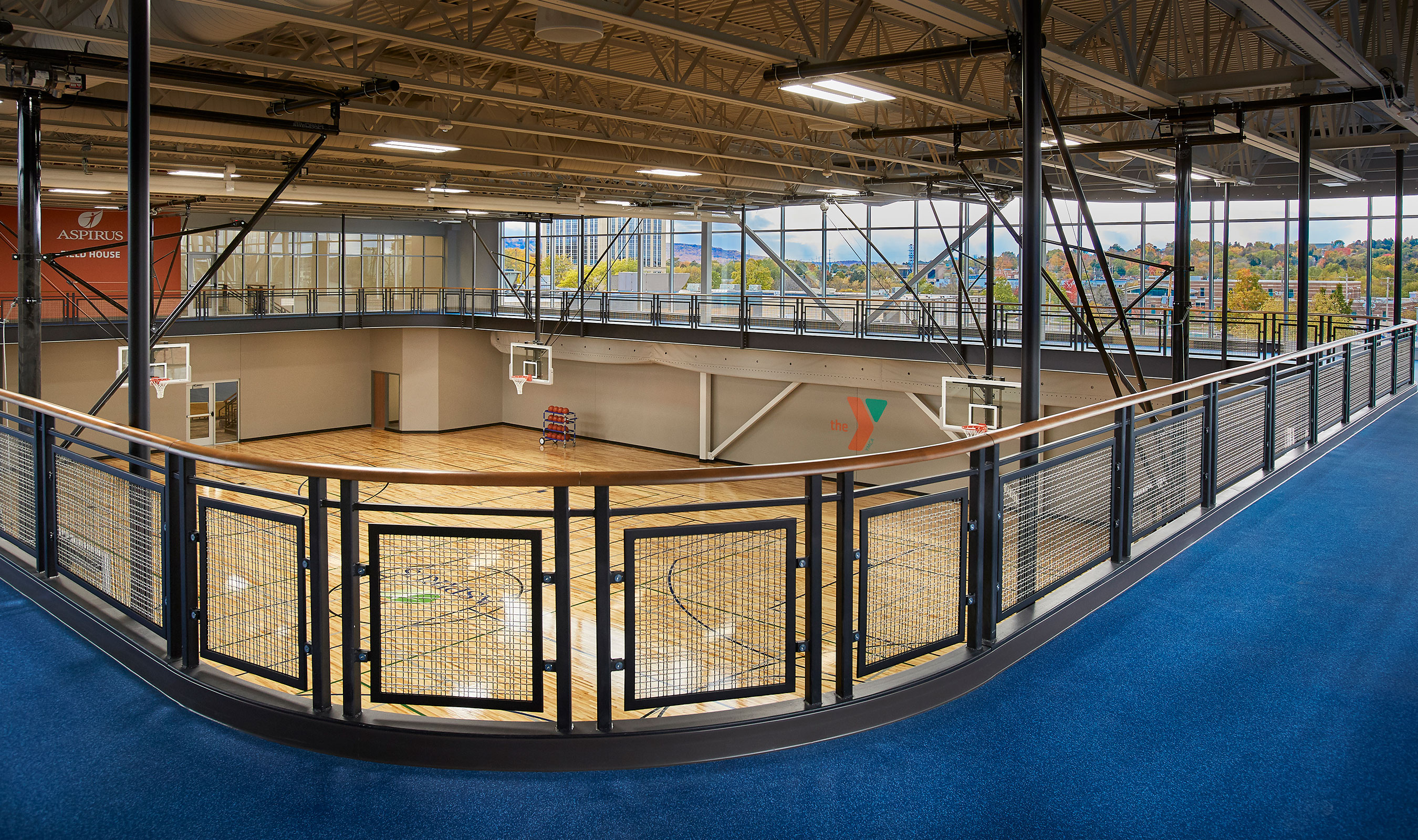 Banker Wire's SJD-2 was chosen as railing infill because it allowed the designer to control the amount fo light that filtered inbehind the backboards to reduce contrast.