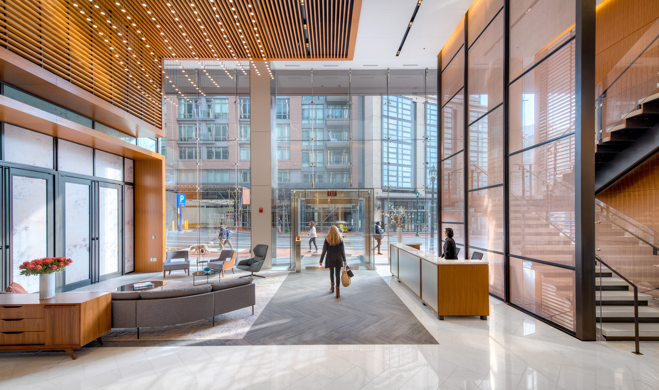 The stainless steel and copper accent wall adds warmth to the office lobby.