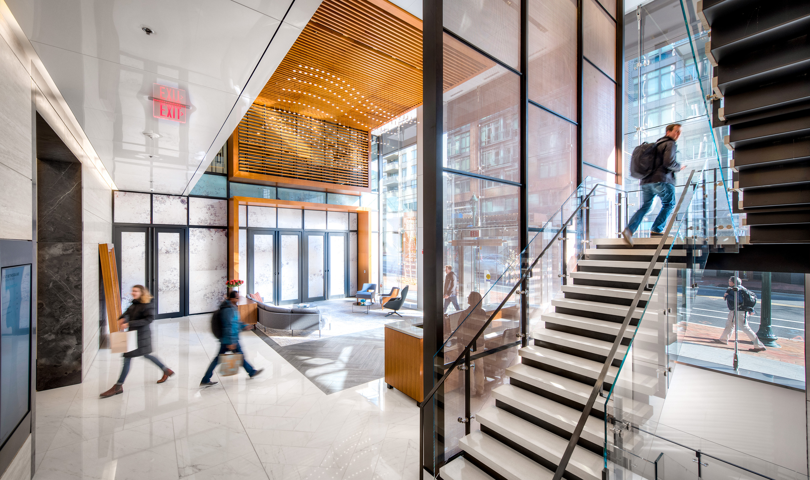 The woven wire mesh screen spans three floors of this workspace.