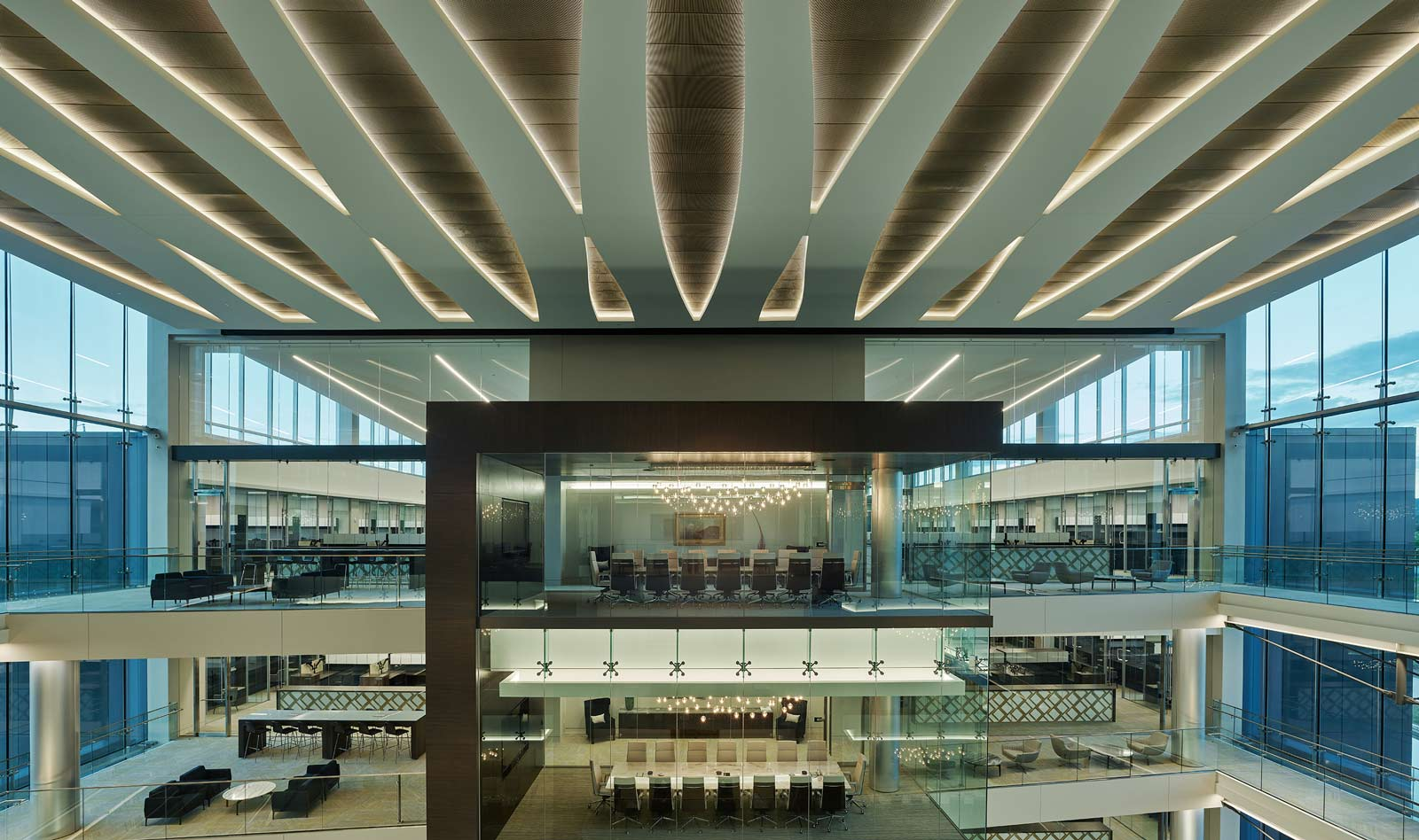 Banker Wire Mesh Adorns Expansive Ceiling Installation Anchoring Five-Story Atrium