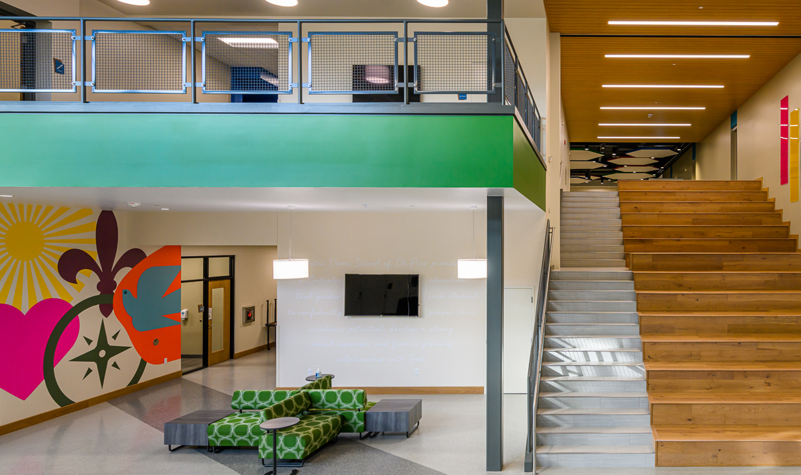The cerulean blue railing infill panel denotes the second floor of the facility.
