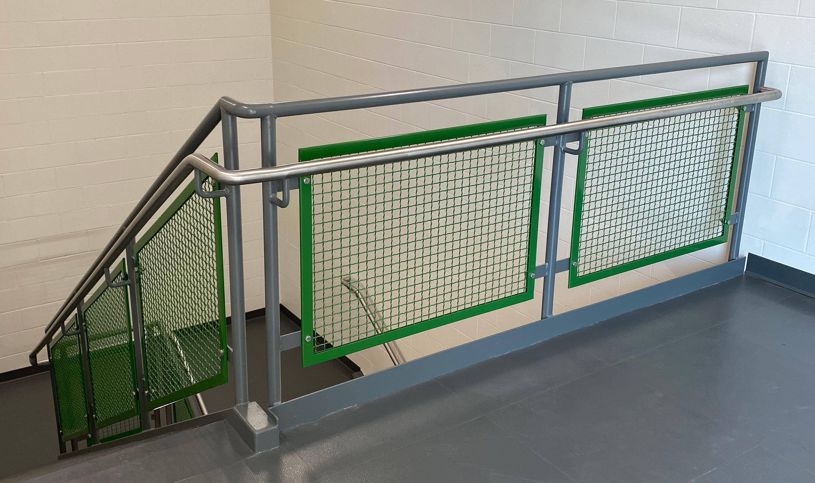 The green painted I-188 railing infill denotes the third floor of the facility.