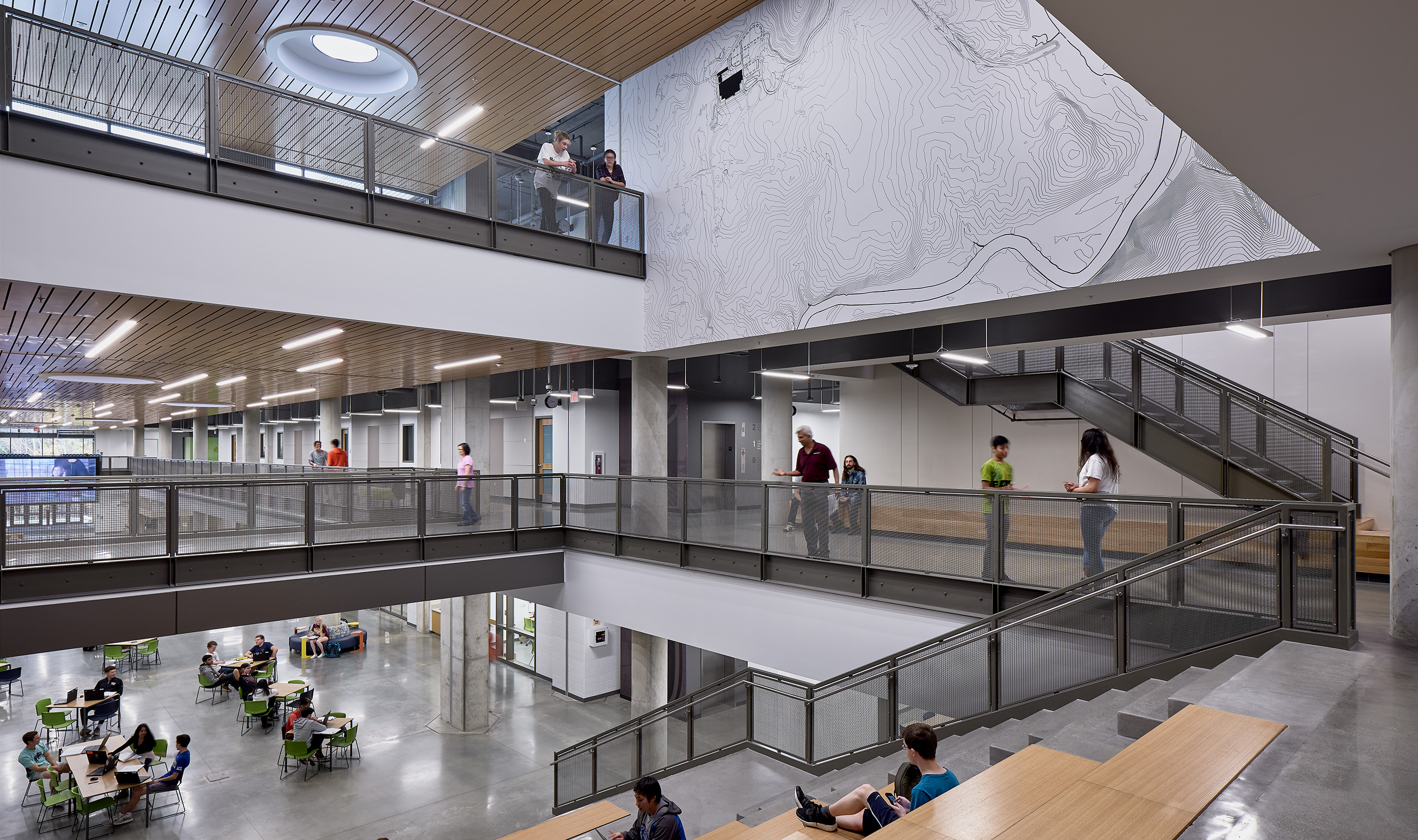 The central common area of the Academies of Loudoun feature Banker Wire's mesh across three stories.