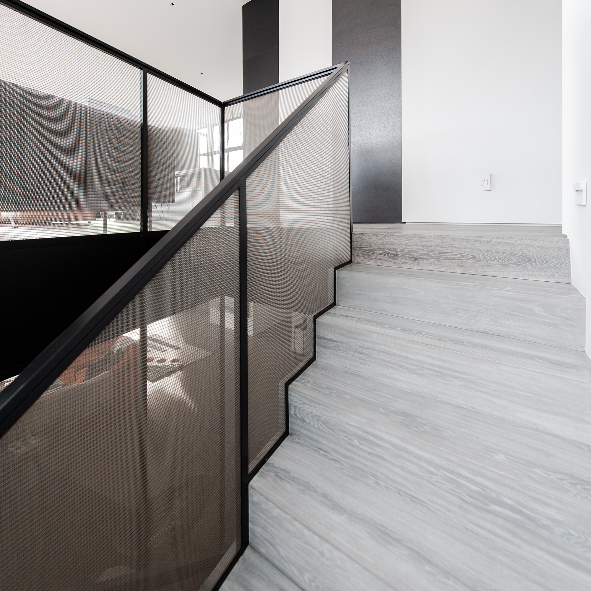 Banker Wire's mesh played the part of railing infill and space divider in this home.