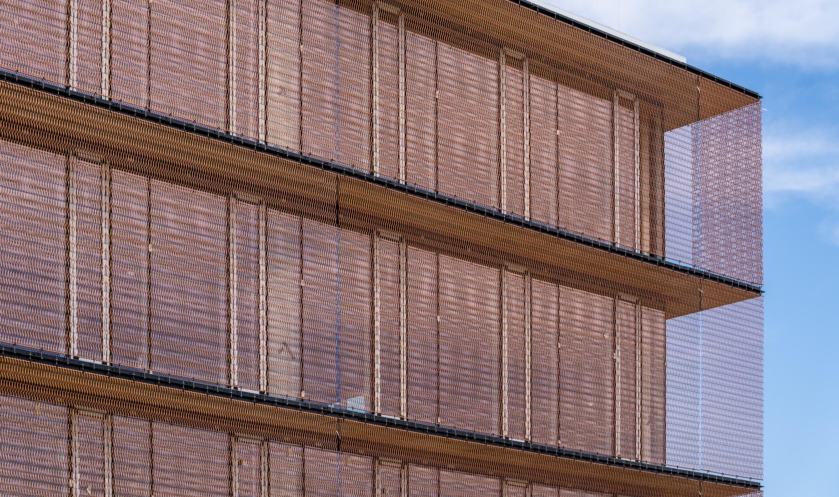 Dune 40100 flexible mesh in Copper for a Building Facade