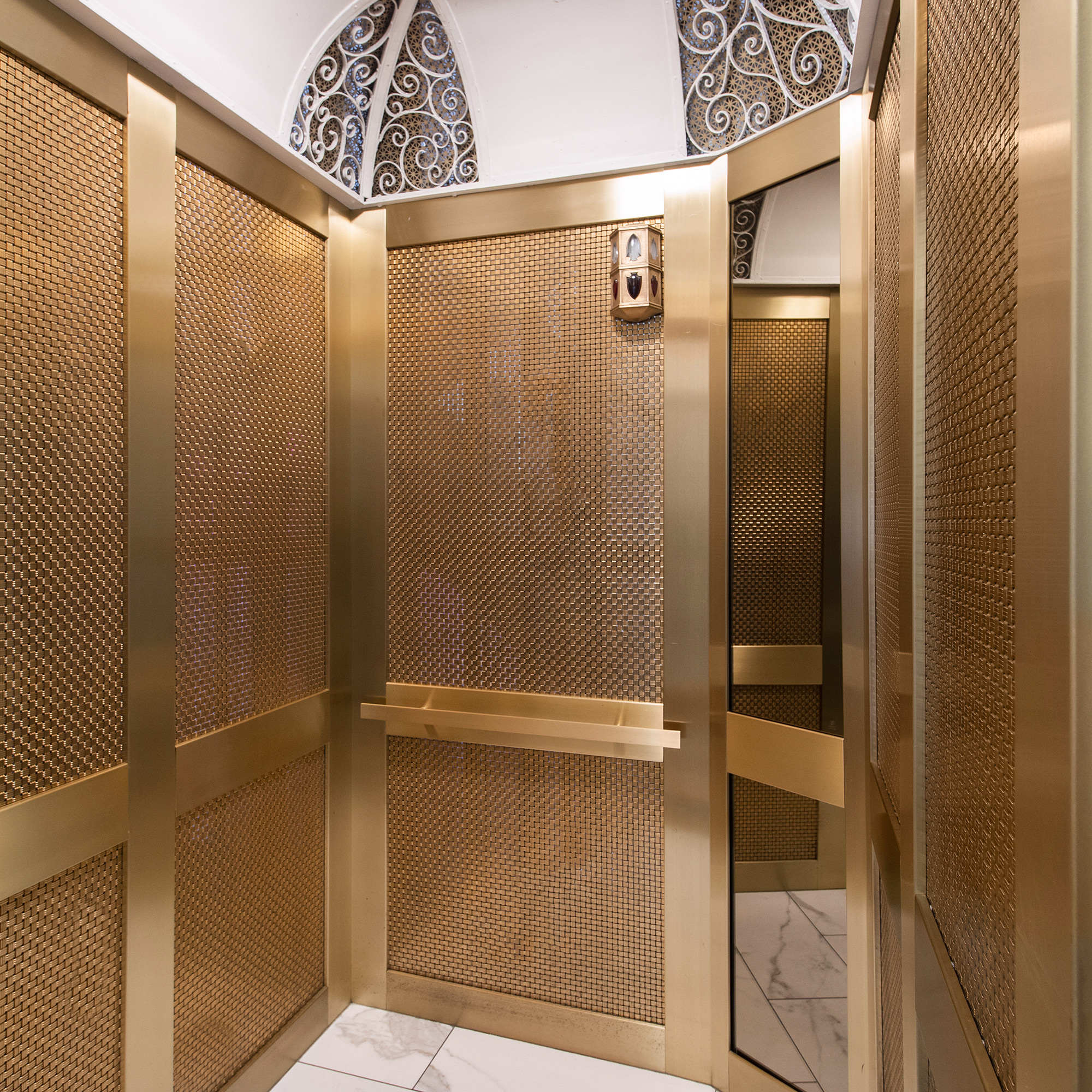 Floor to ceiling wire mesh panels make for a classic and elegant design.