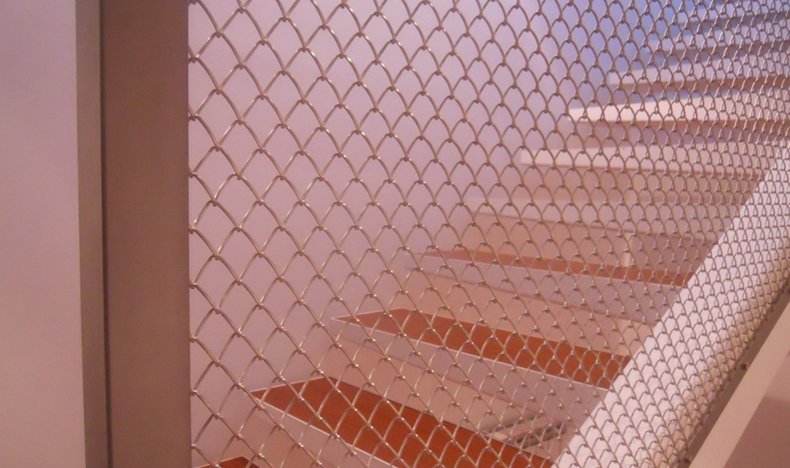Flow Flat spiral mesh weave used as a staircase divider