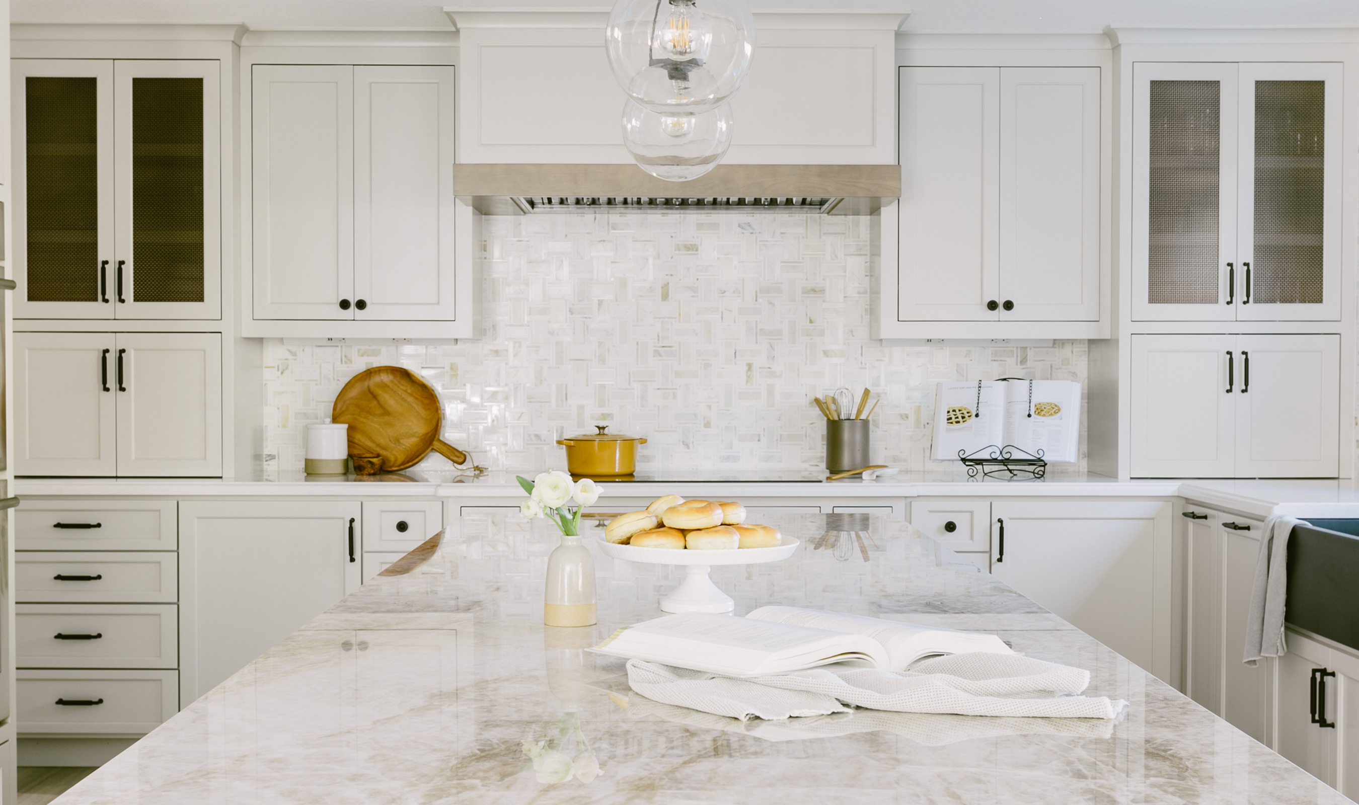 The rich brass tones of S-12 bring out the warmth in the marble backsplash and countertops.
