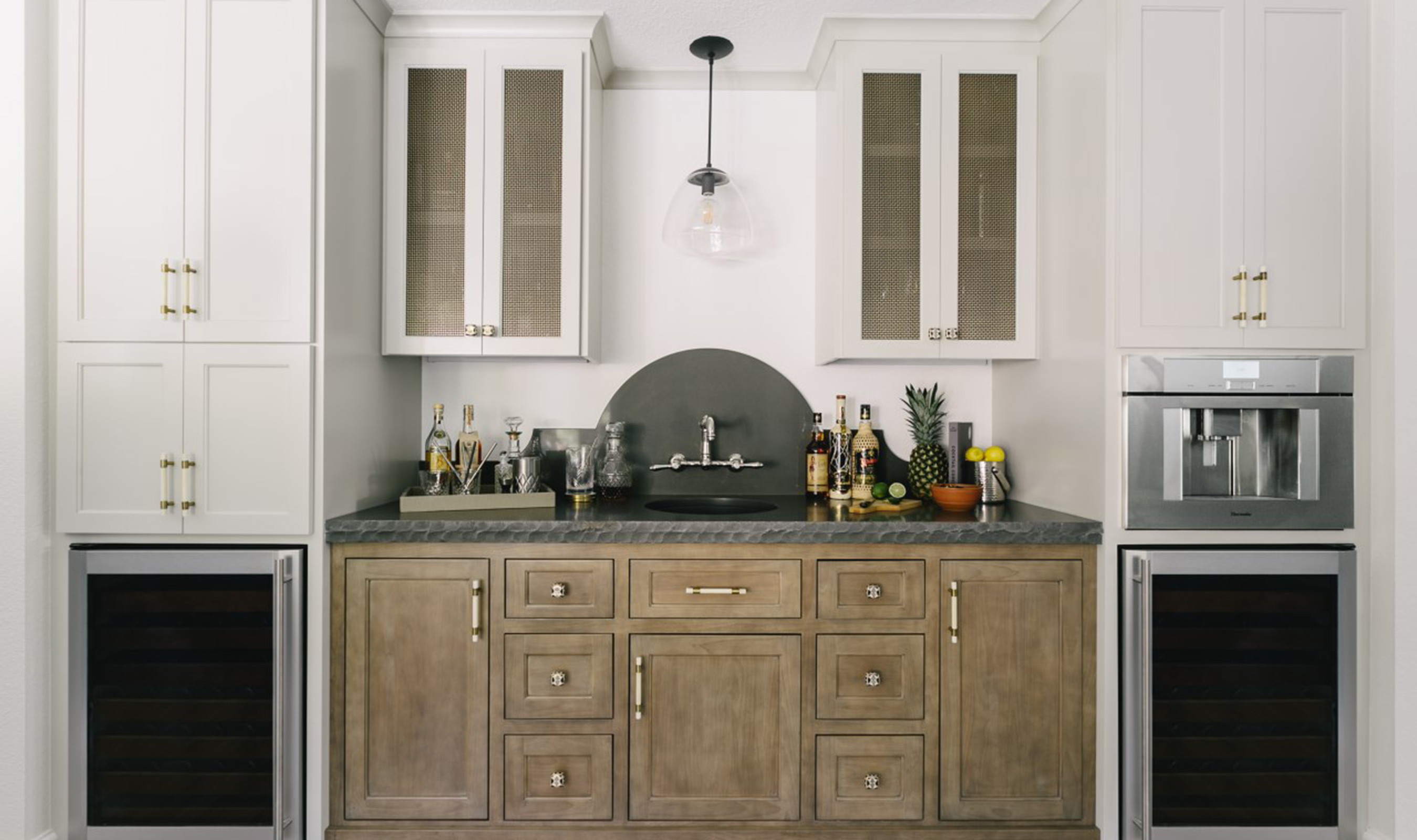 S-12's Antique Brass plated finish brings balance to the home's bar area.