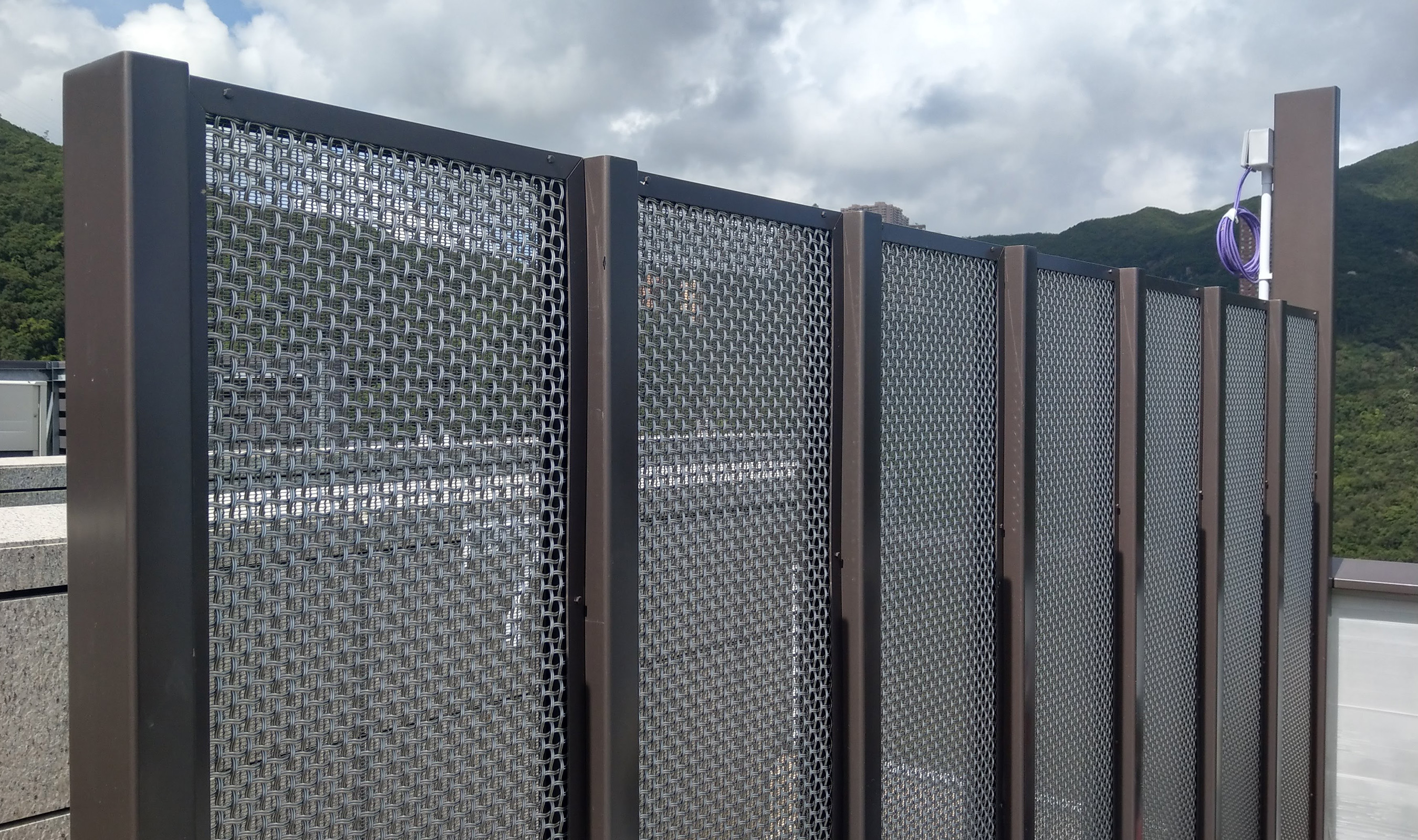 Woven wire mesh panels hide industrial equipment, giving the space a cozier atmosphere.