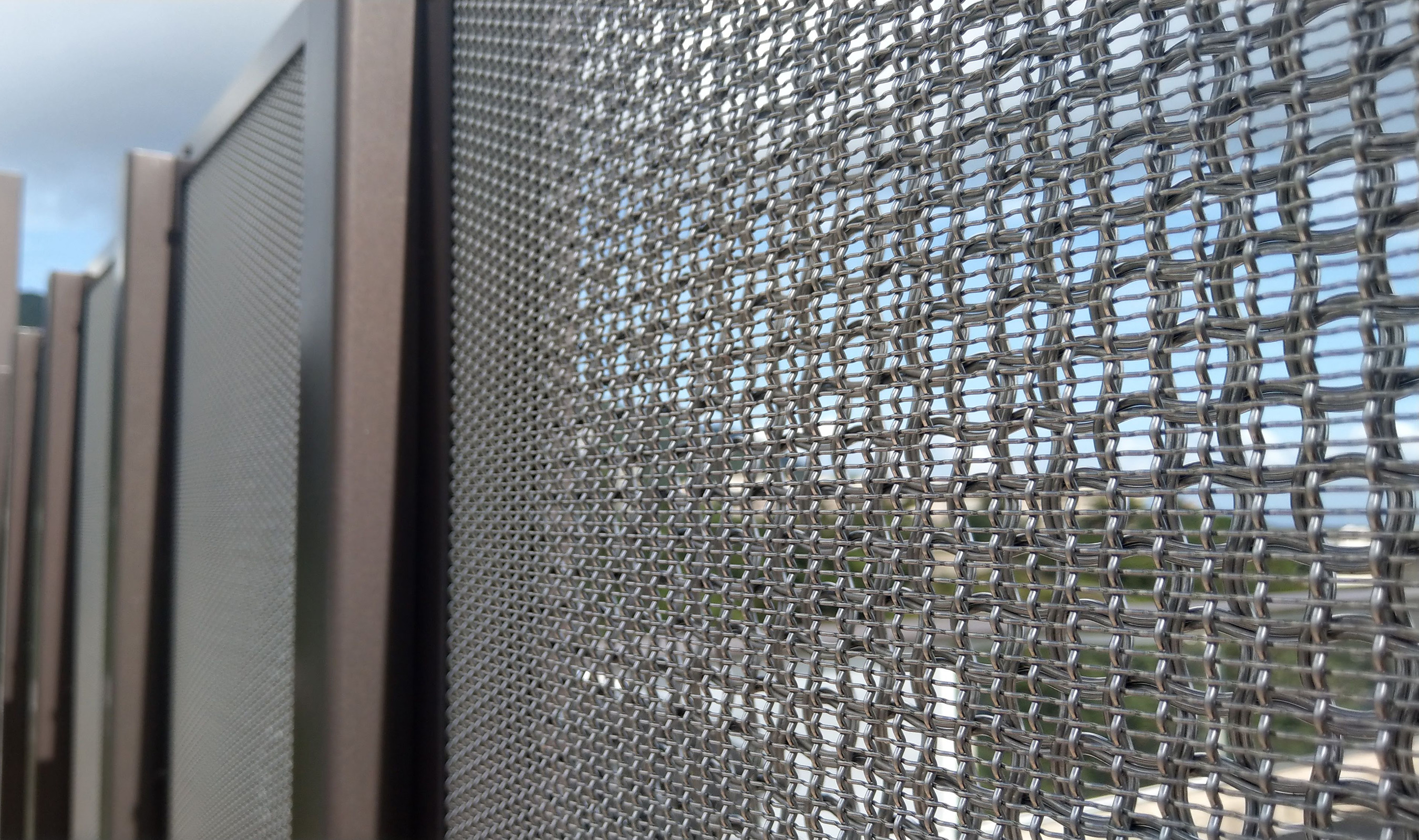 They obscuring effect of the layered wire mesh is enhanced when viewed at an angle.