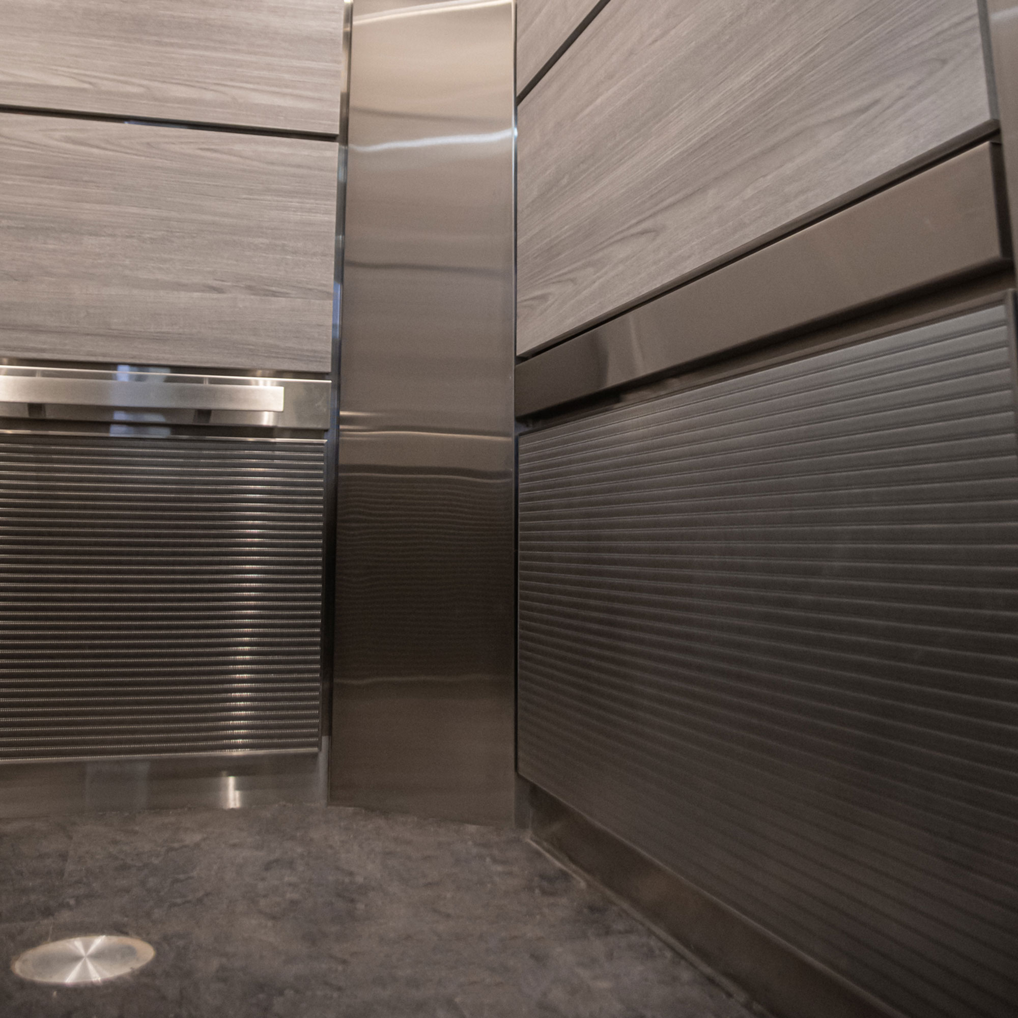 Banker's stainless steel wire mesh panels in the elevator cab.