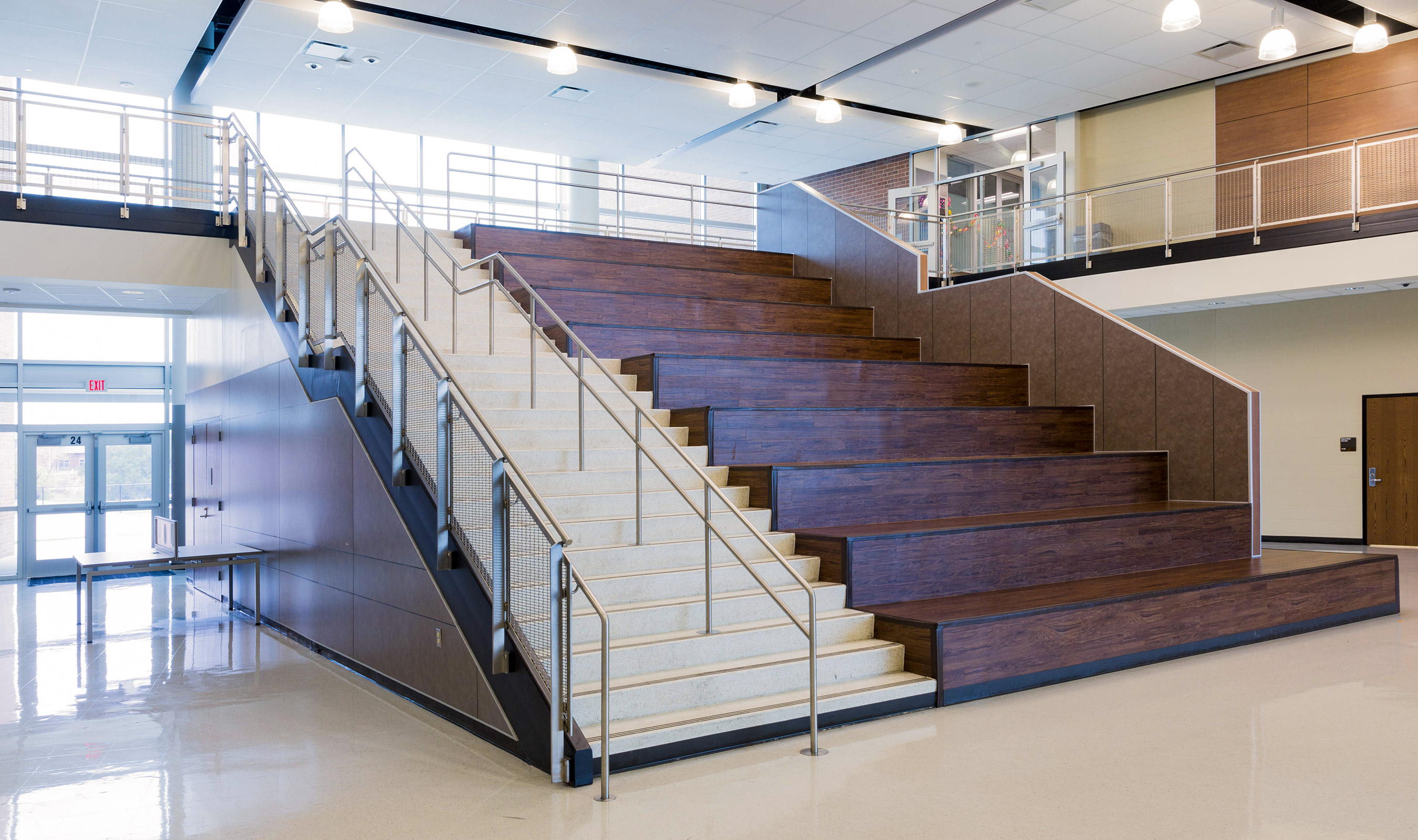 Banker Wire's woven wire mesh in stainless steel as railing infill on main stairs.