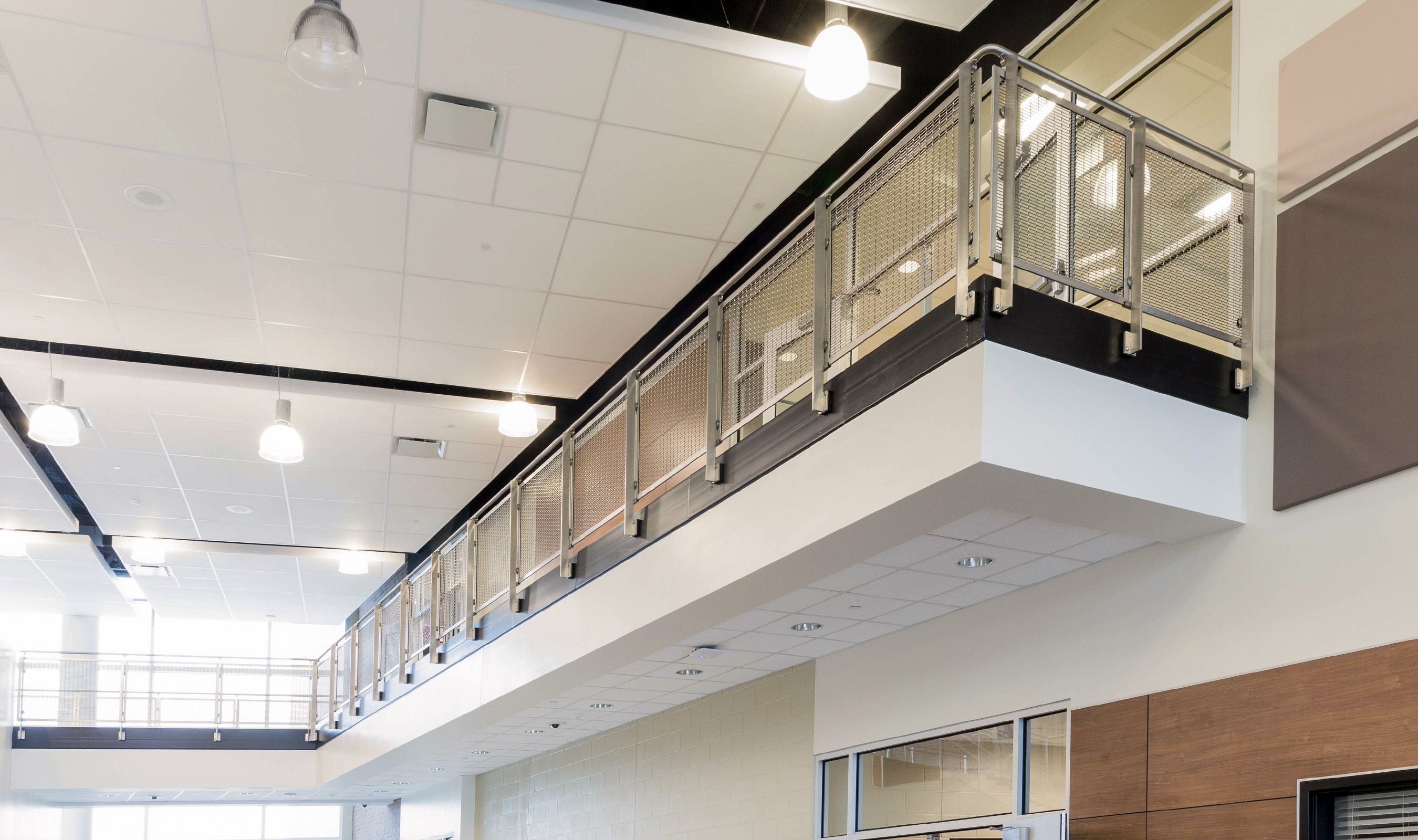 Banker Wire's woven wire mesh in stainless steel as balcony railing infill.