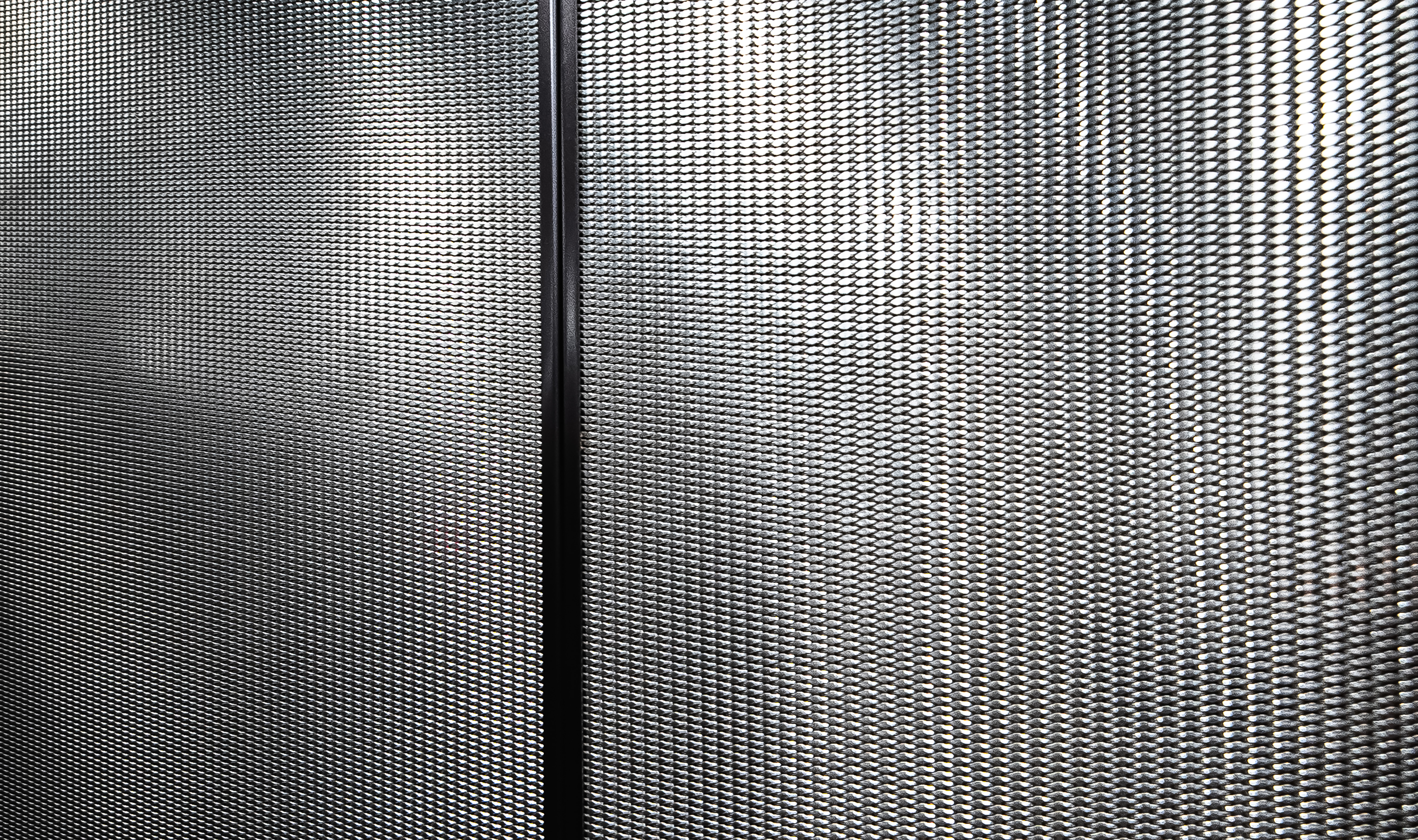 Banker Wire's woven wire mesh pattern DS-2 adds a unique texture to the elevator interior.