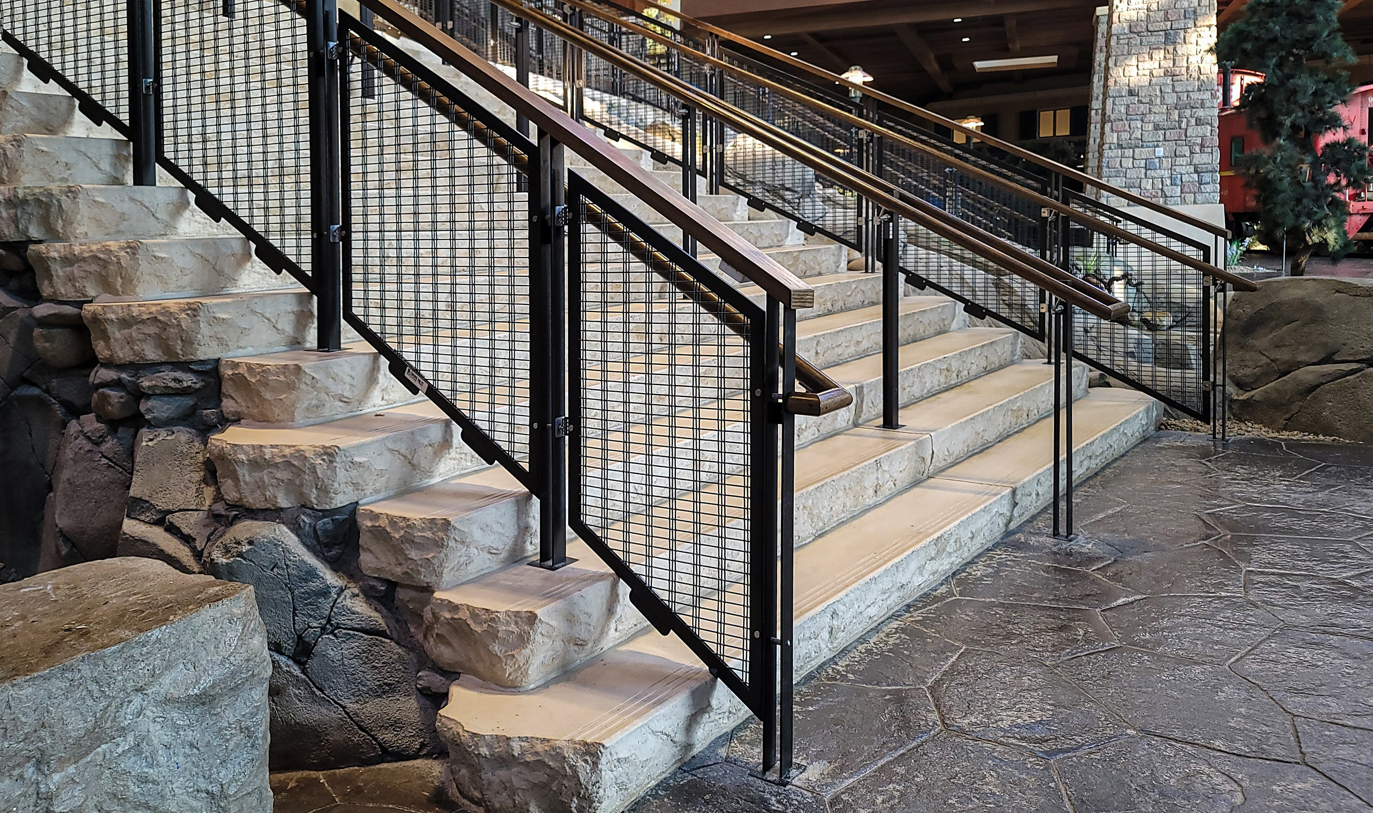 The black wire mesh railing infills are made from Banker Wire's M13Z-146.