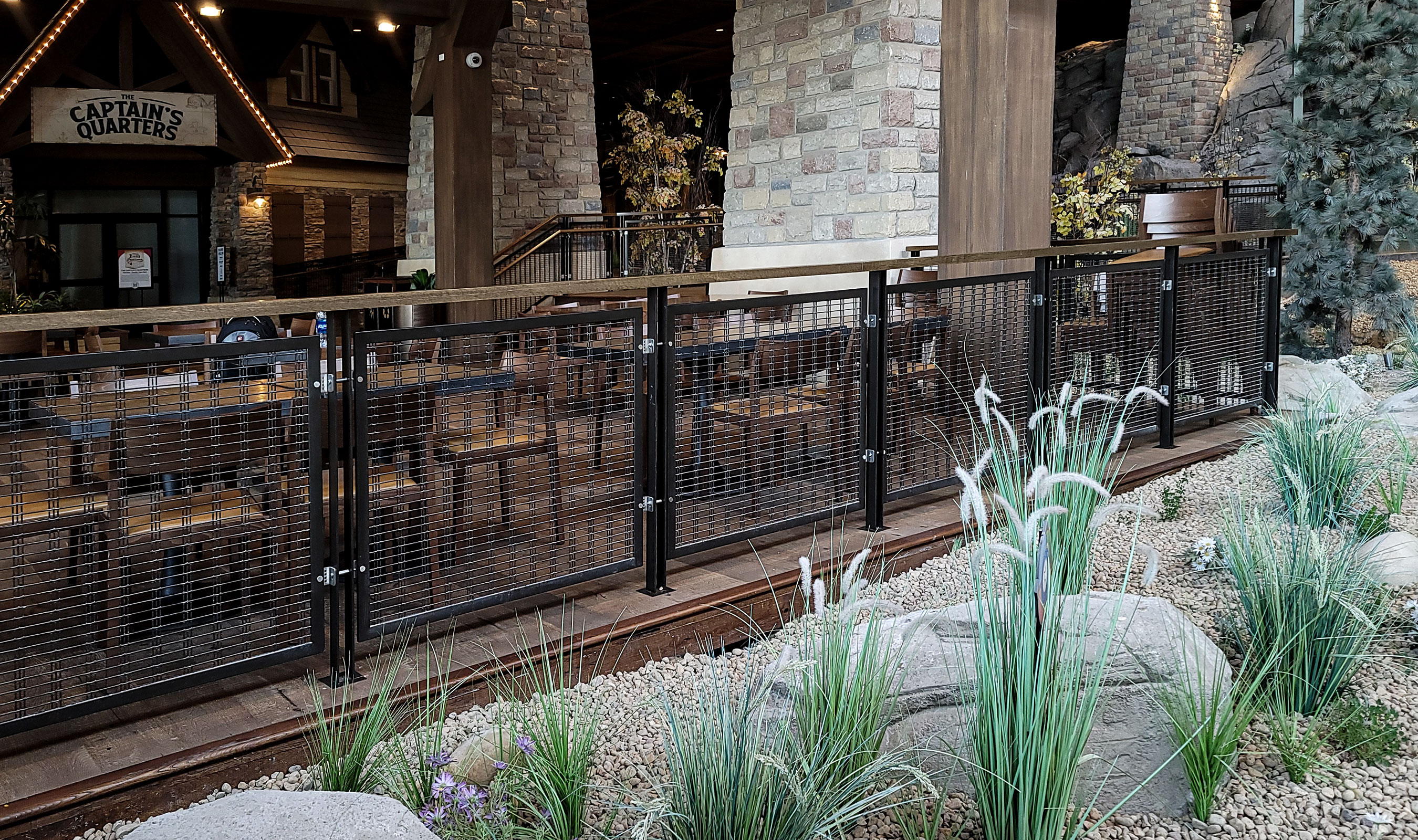 The common area restaurant patio is surrounded by black metal railings.