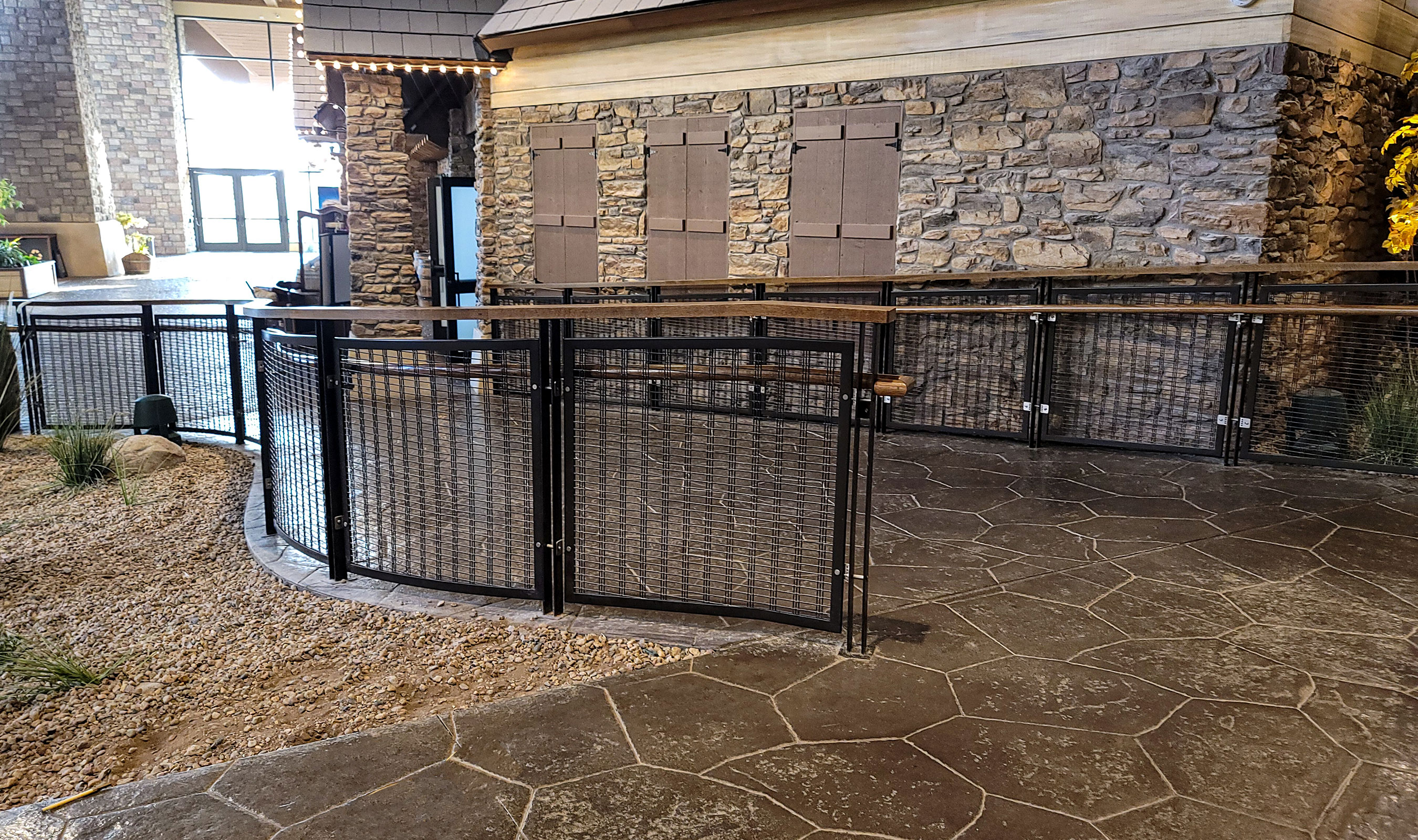 The wire mesh railing infills are curved along with the frame to follow the winding paths.